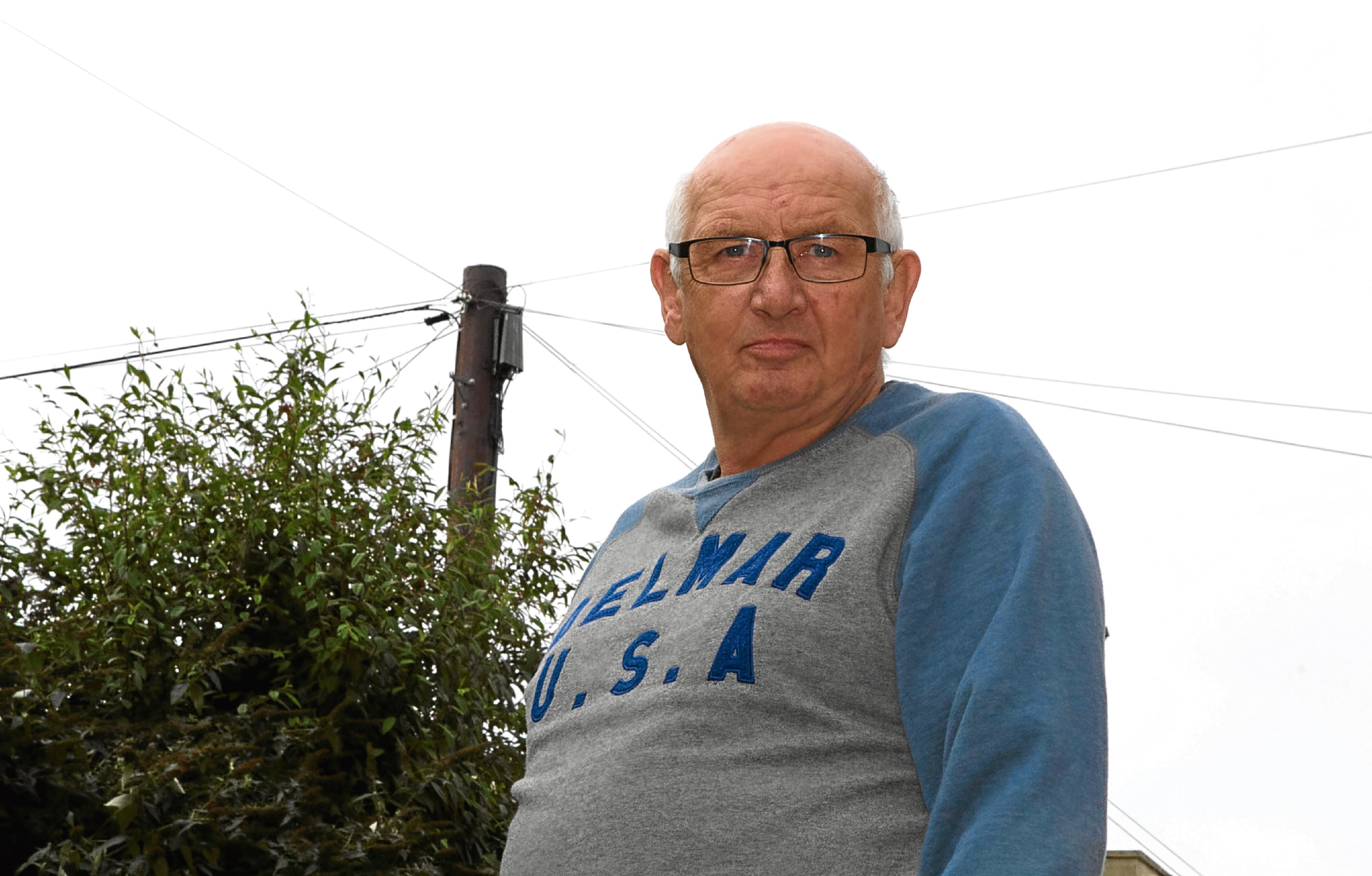 Sandy Massie needed a new phone line put in place in his back garden (although the pole was actually situated in a neighbour's garden)