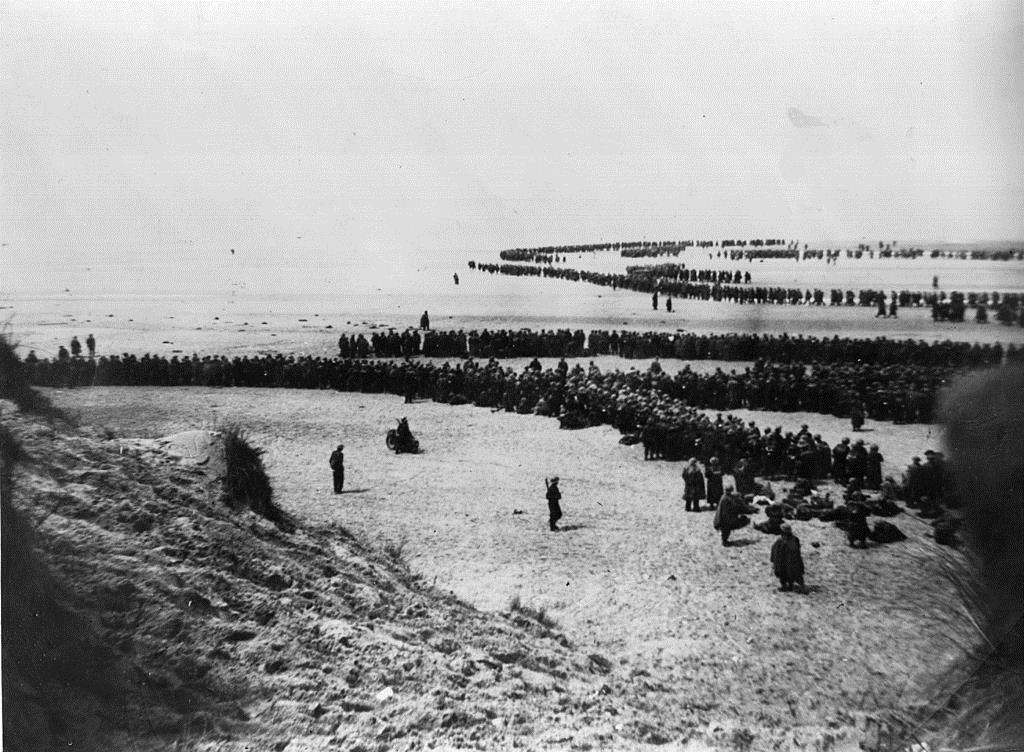 Defeated British and French troops waiting on the dunes at Dunkirk to be picked up by the Destroyers and taken back to England (Photo by Topical Press Agency/Getty Images)