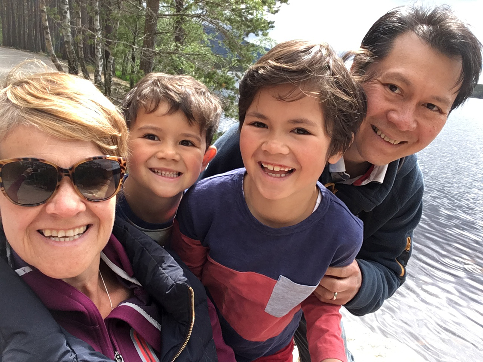Anne MacLean-Chang is battling cancer for a fourth time - but has been refused a widely hailed breast cancer treatment called Kadcyla on the NHS. L-R Anne, children Ollie, Nathan and husband Winston