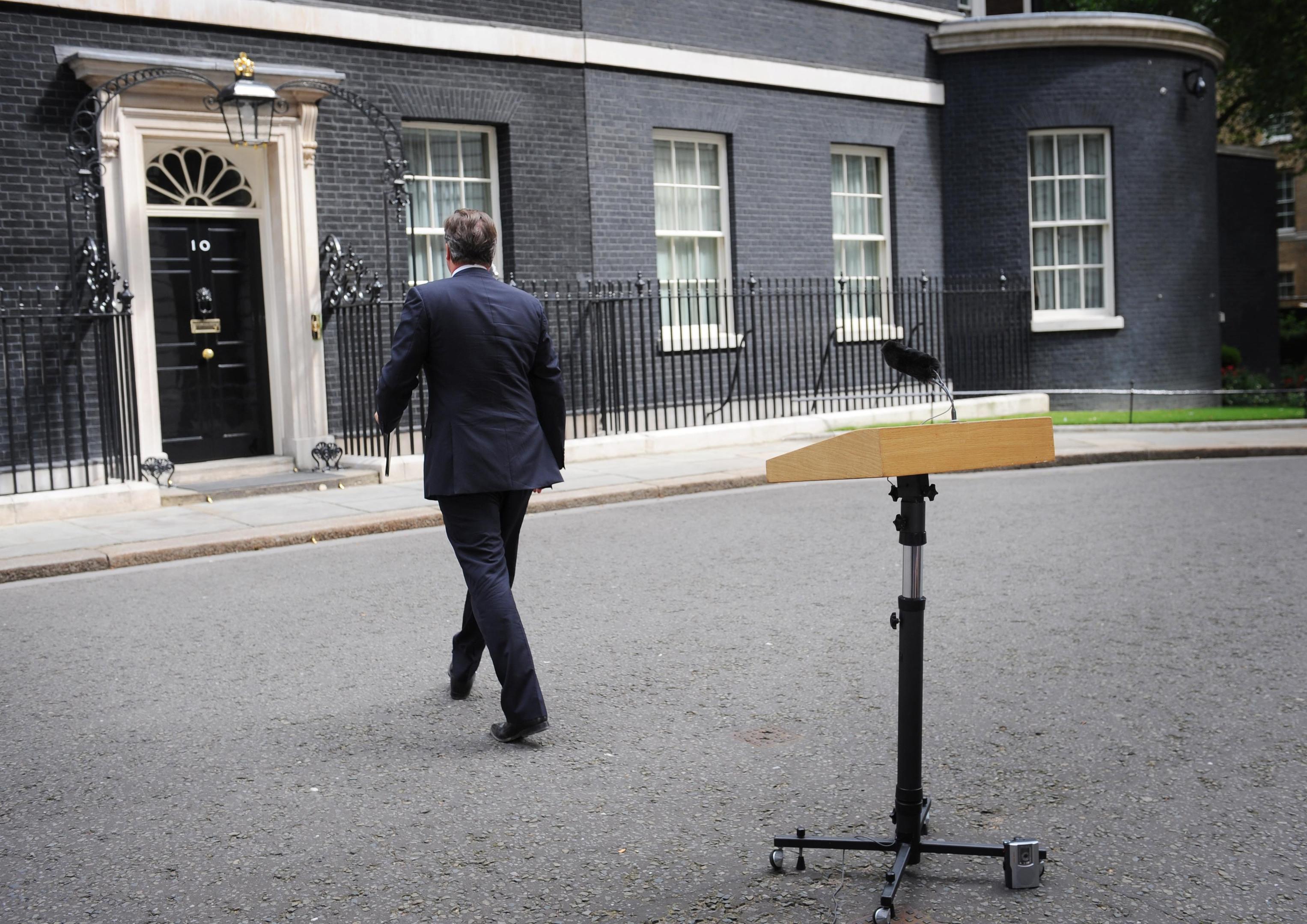 Prime Minister David Cameron leaves (PA)