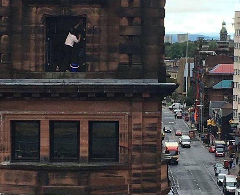 Cleaning windows on Sauchiehall Street (Kieran Turner)