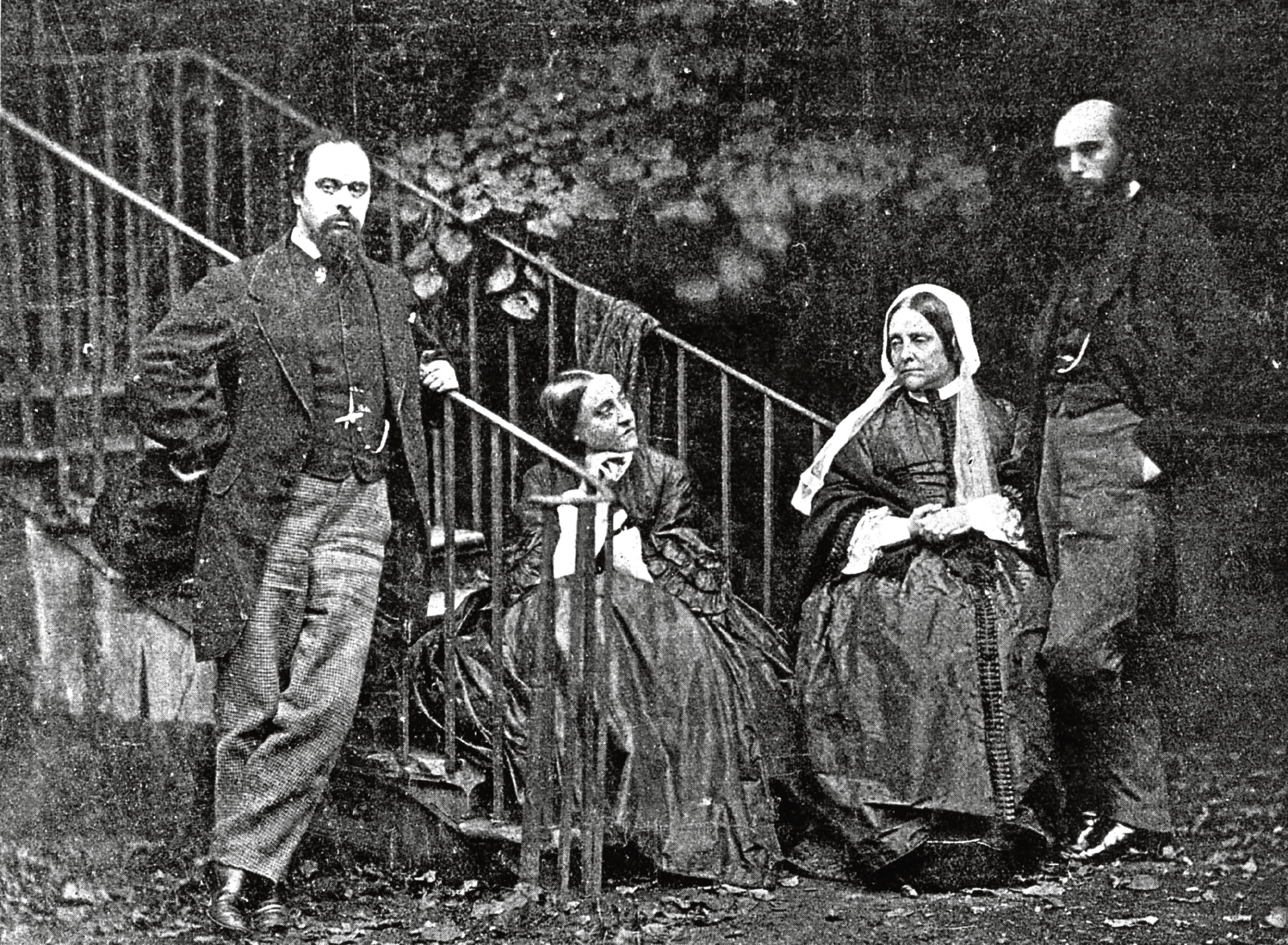 Poet and painter Dante Gabriel Rossetti, poet Christina Rossetti and art critic William Michael Rossetti with their mother in the garden of Rossetti's house in Chelsea, London. (Photo by Lewis Carroll/Getty Images)