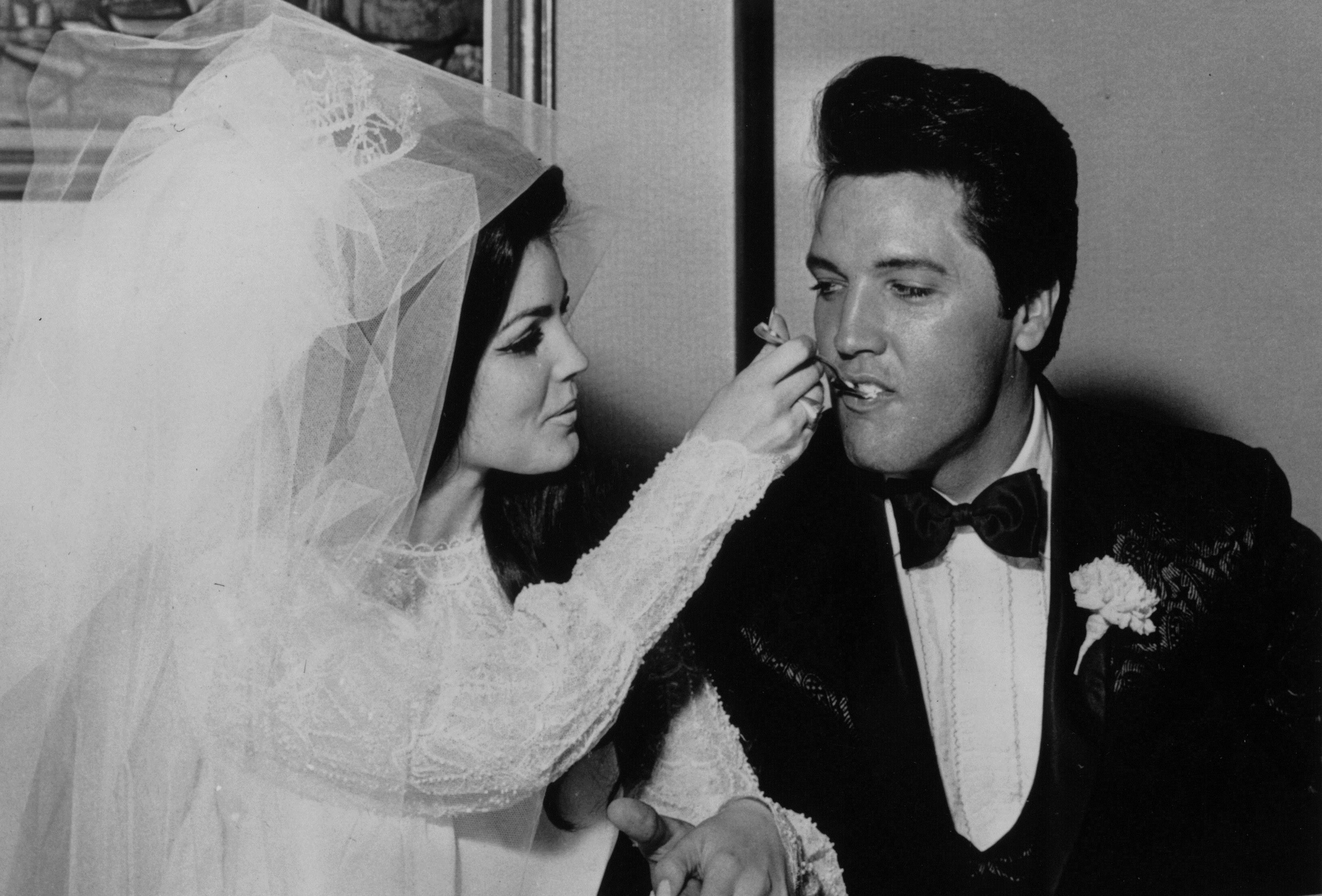 Elvis being fed a mouthful of wedding cake by his bride Priscilla at the Aladdin Hotel, Las Vegas. (Keystone/Getty Images)