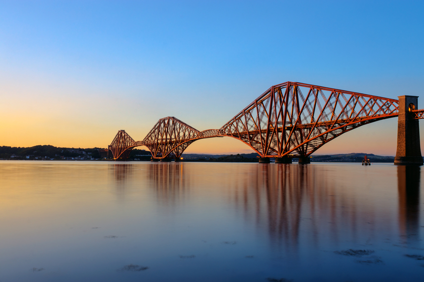 The Forth Rail Bridge in Scotland at sunset