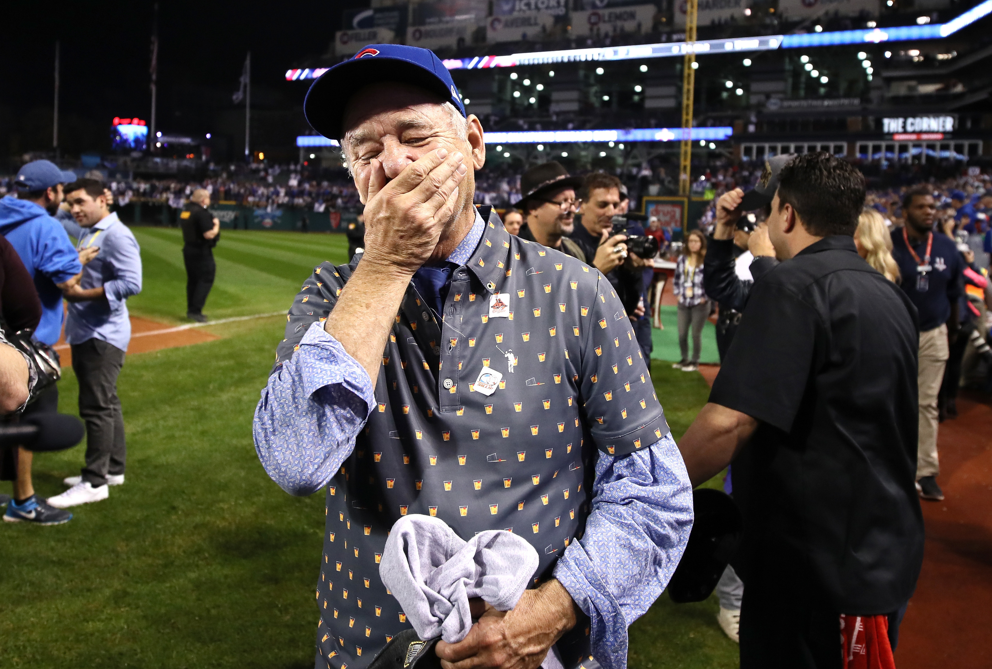 Actor Bill Murray reacts on the field after the Chicago Cubs defeated the Cleveland Indians (Ezra Shaw/Getty Images)