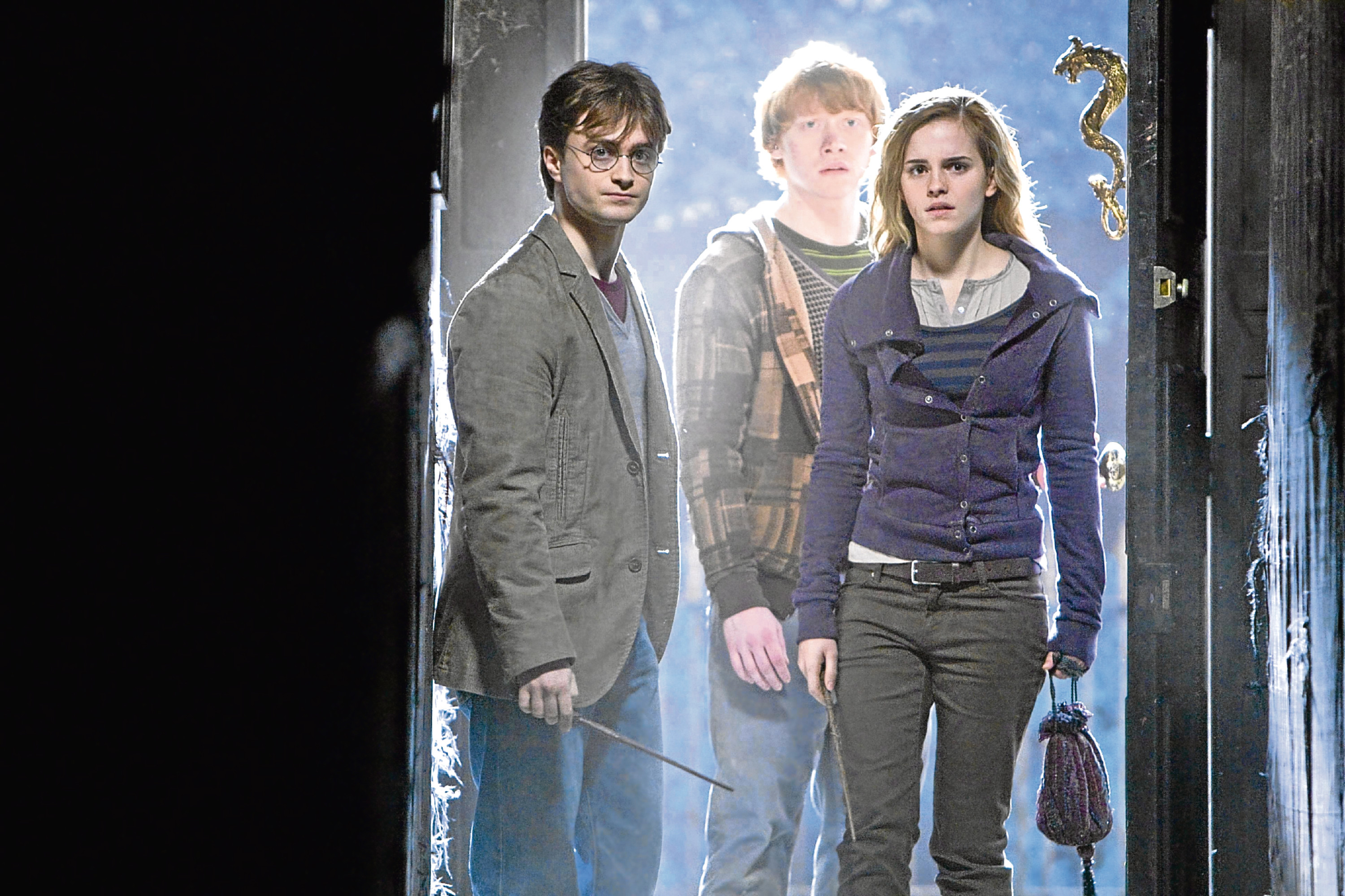 Daniel Radcliffe as Harry Potter, Rupert Grint as Ron Weasley and Emma Watson as Hermione Granger (PA Photo/Warner Bros)