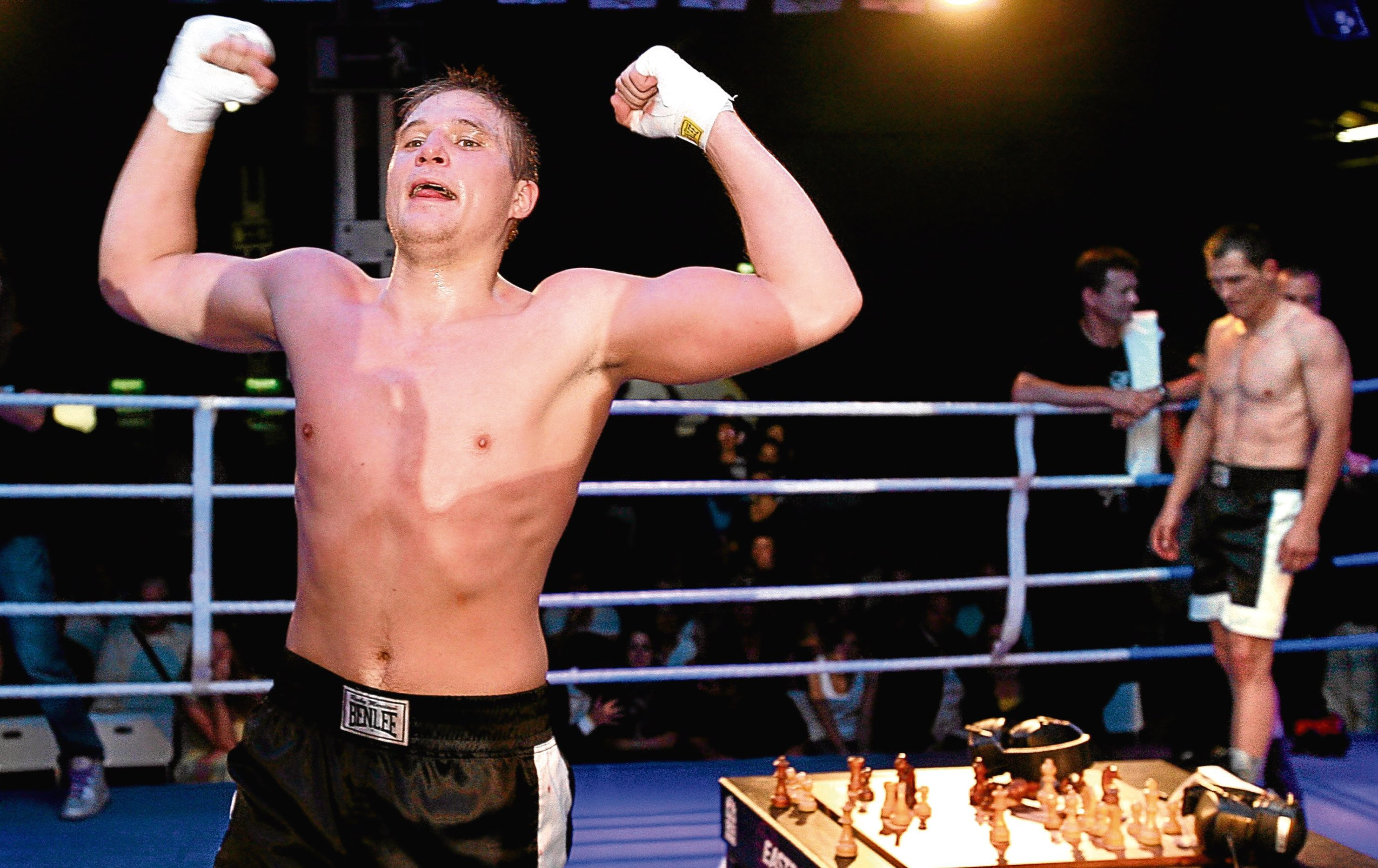 Russian Nikolay Sazhin (L) celebrates his win over German Frank Stoldt (R) after claiming the light heavyweight world championship title in chess boxing (EPA/WOLFGANG KUMM)