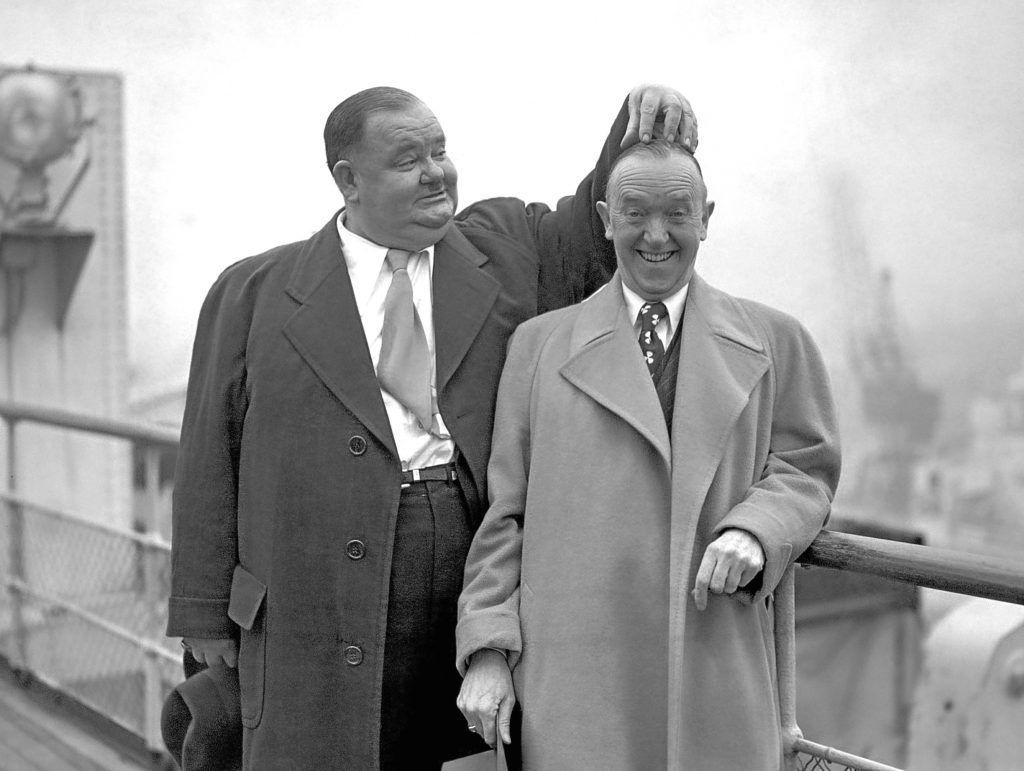 Oliver Hardy scratches the head of Stan Laurel, 1932 (PA Wire)
