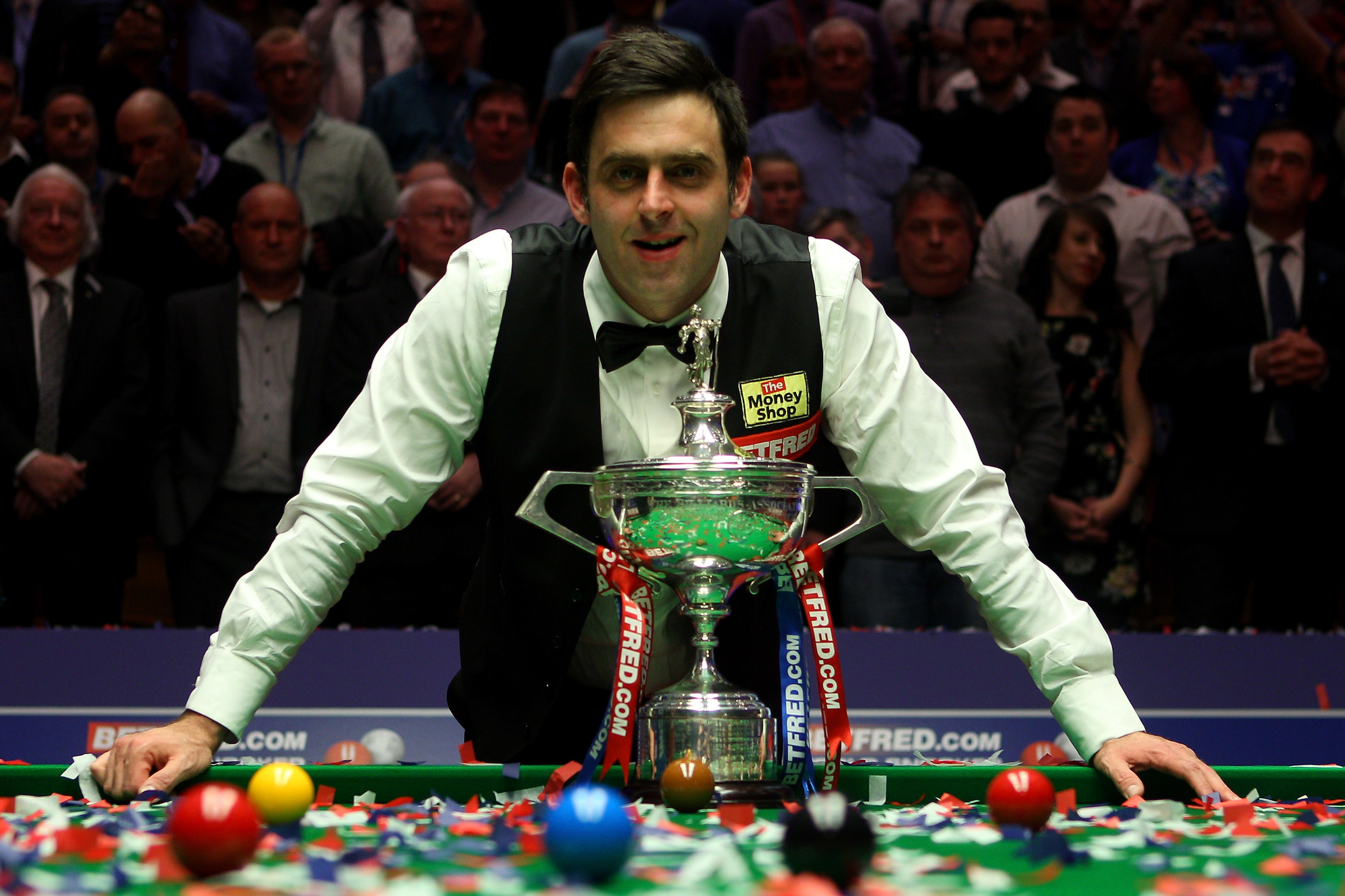 Ronnie O'Sullivan of England poses with the trophy after beating Allister Carter of England in the final of the Betfred.com World Snooker Championship, 2012 (Photo by Warren Little/Getty Images)