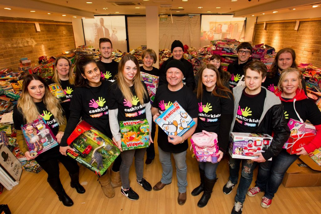 Ian Robertson (centre) with volunteers who are sorting through the toys (Andrew Cawley / DC Thomson)