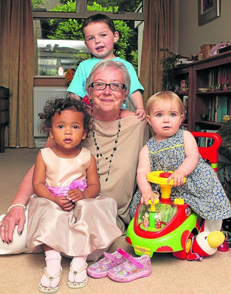 Sunday Post columnist Margaret Clayton with 3 of her grandchildren, Jamila, Jack and Emily.
