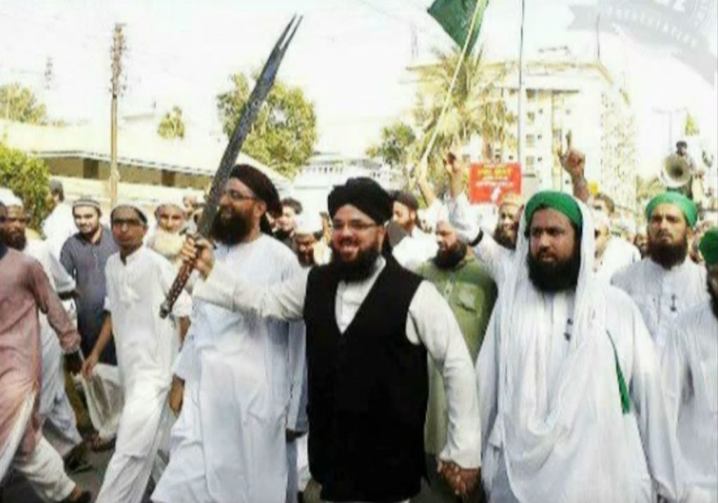 Allama Syed Muzaffar (with sword)