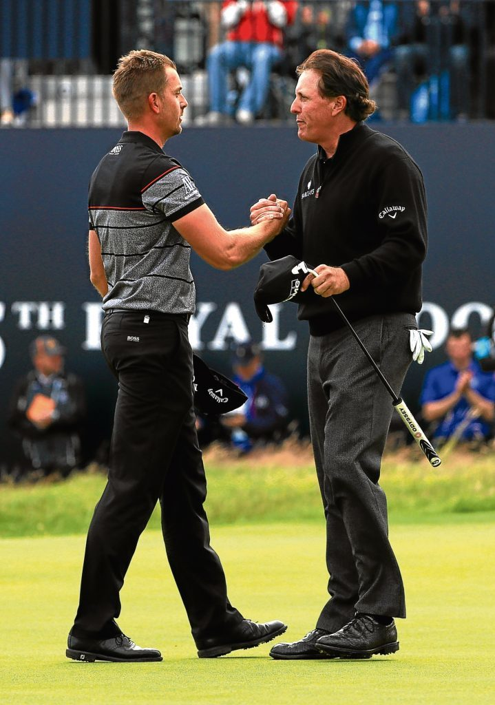Henrik Stenson celebrates victory on the 18th green with Phil Mickelson (Mike Ehrmann/Getty Images)