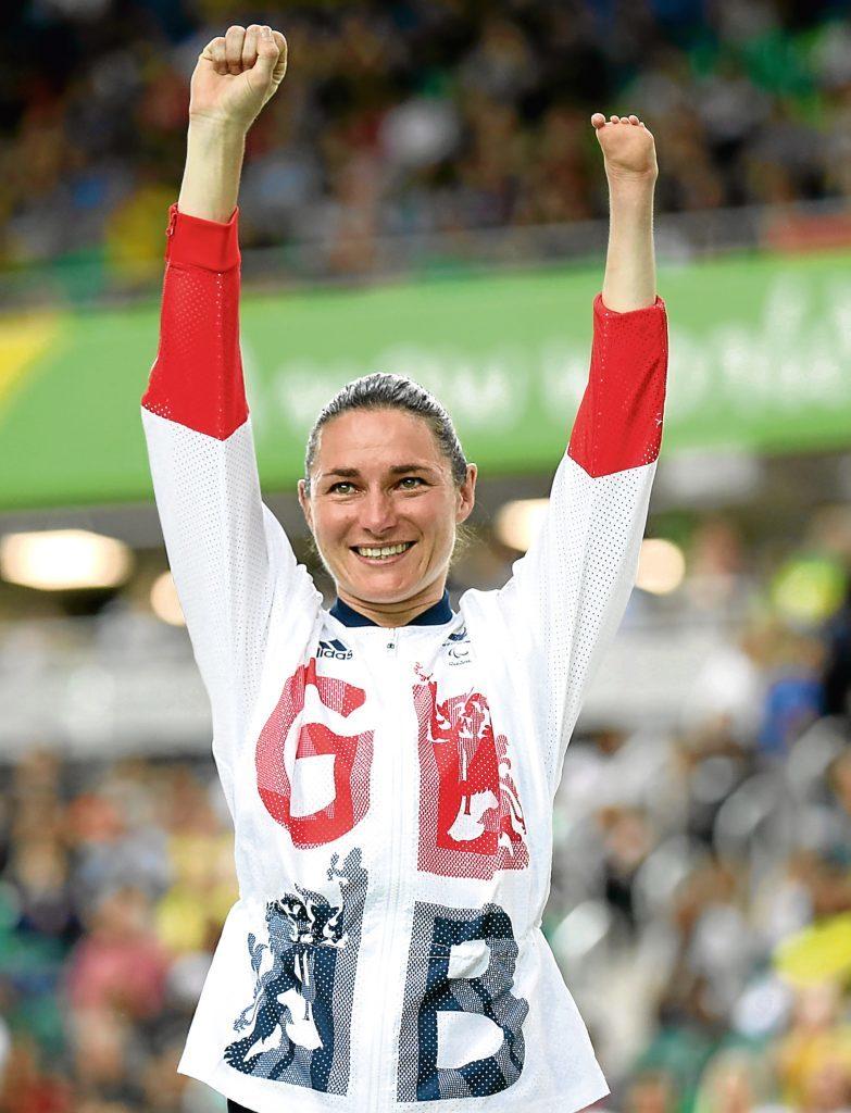 Sarah Storey celebrates on the podium (Friedemann Vogel/Getty Images)