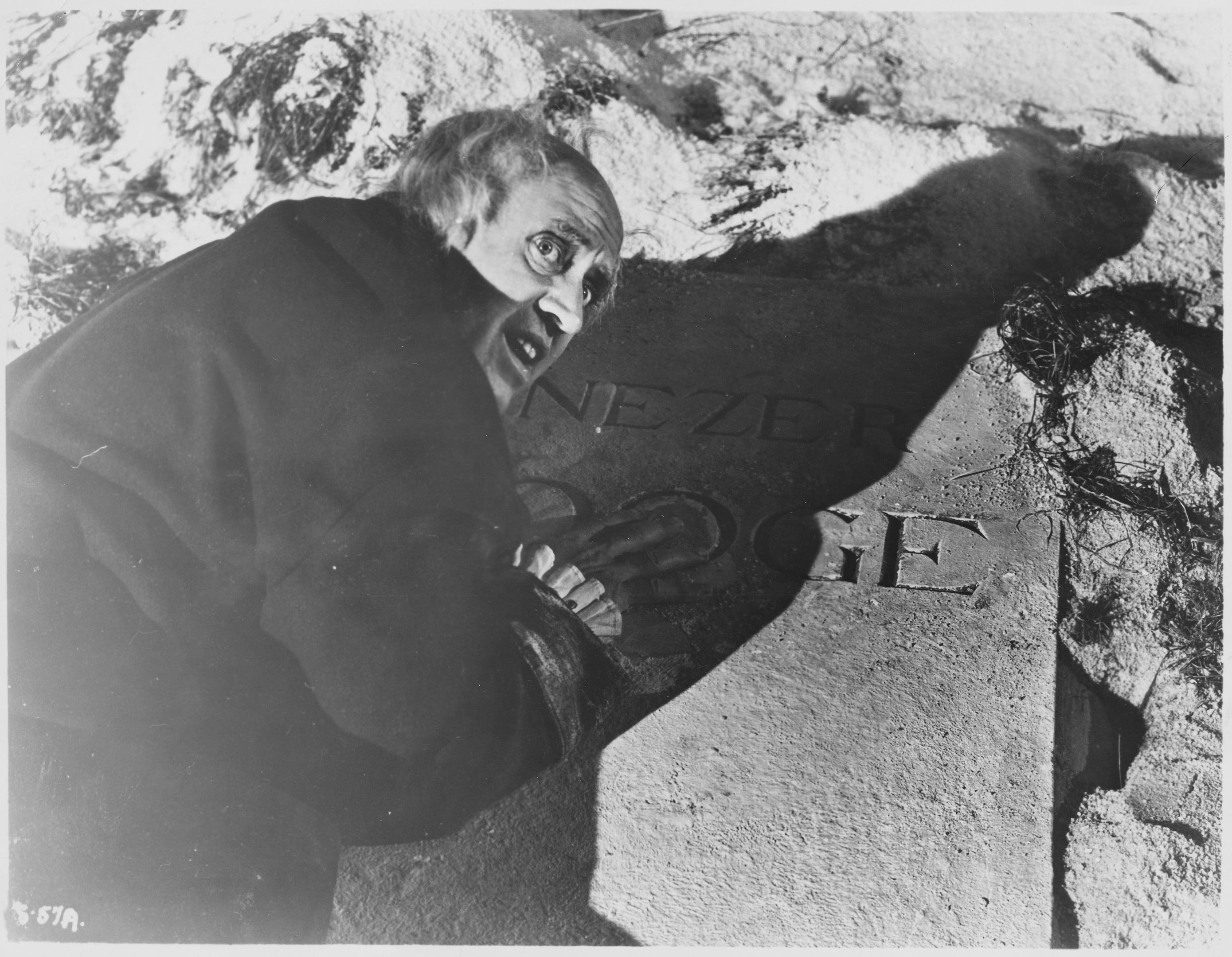 Ebenezer Scrooge (Alastair Sim) leans on his own grave marker, horrified at what may become if he doesn't change his ways, in A Christmas Carol 1951. (John Springer Collection/CORBIS/Corbis via Getty Images)