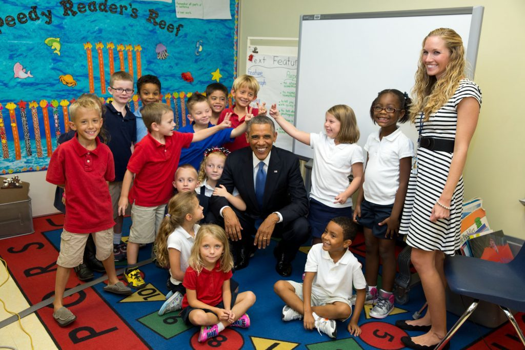 """Sept. 17, 2014 """"'Don't make rabbit ears', the President said to a group of students before taking a photo with them. Which of course some of them couldn't resist doing. I especially love the girl with her arm wrapped around the President's arm. The students were from an elementary school at MacDill Air Force Base in Tampa, Florida. (Official White House Photo by Pete Souza)"""