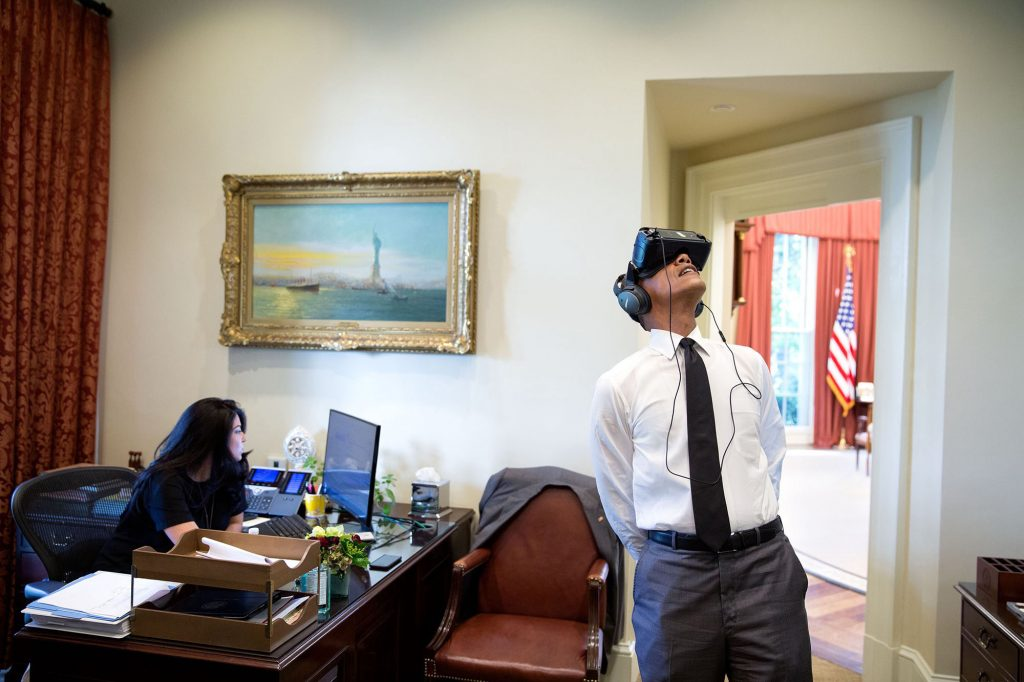 """Aug. 24, 2016 """"President Obama watches a virtual reality film captured during his trip to Yosemite National Park earlier this summer as Personal Aide Ferial Govashiri continues working at her computer."""" (Official White House Photo by Pete Souza)"""