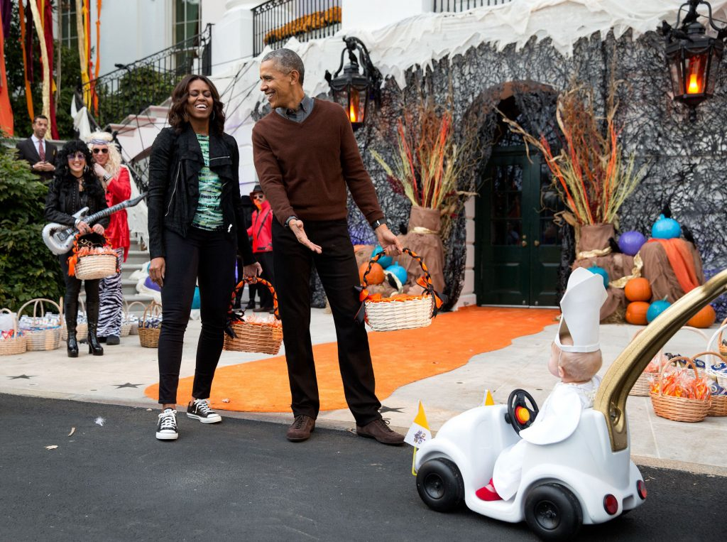 """Oct. 30, 2015 """"The President and First Lady react to a child in a pope costume and mini popemobile as they welcomed children during a Halloween event on the South Lawn of the White House."""" (Official White House Photo by Pete Souza)"""