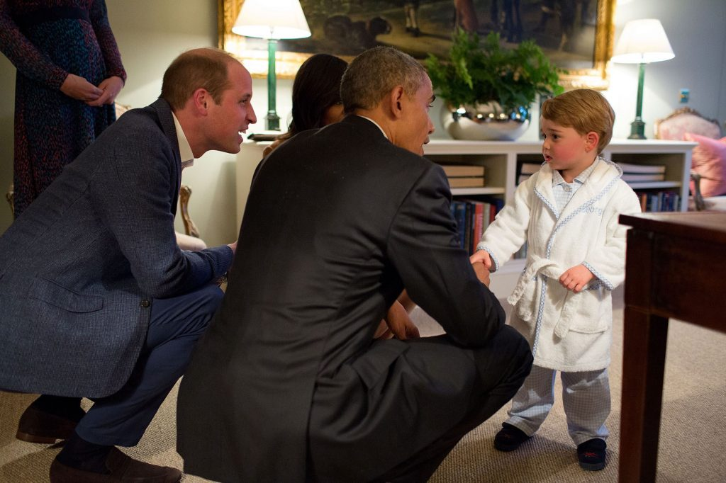 """April 22, 2016 """"Originally it was unclear whether I would be permitted to photograph the President meeting Prince George. But the night before, our advance team called and said they had gotten word from Kensington Palace that they would allow me access to make candid photographs during their visit. Afterwards, this photograph garnered the most attention but at the time all I could think was how the table at right was hindering my ability to be at the optimum angle for this moment."""" (Official White House Photo by Pete Souza)"""
