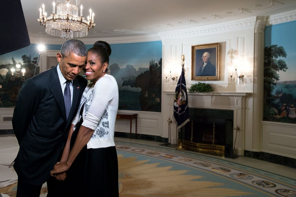 """March 27, 2015 """"The First Lady snuggled against the President during a video taping for the 2015 World Expo in the Diplomatic Reception Room of the White House."""" (Official White House Photo by Amanda Lucidon)"""