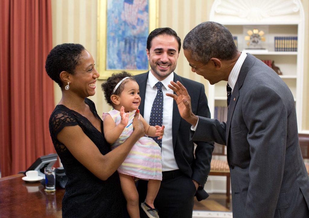 """Sept. 21, 2015 """"The President exchanges a wave with Alya Dorelien Bitar, one-year-old daughter of Maher Bitar, the outgoing National Security Council Director for Israeli and Palestinian Affairs, and his wife, Astrid Dorelien, during a family photo in the Oval Office."""" (Official White House Photo by Pete Souza)"""