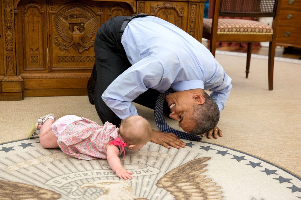 """June 4, 2015 """"At the President's insistence, Deputy National Security Advisor Ben Rhodes brought his daughter Ella by for a visit. As she was crawling around the Oval Office, the President got down on his hands and knees to look her in the eye."""" (Official White House Photo by Pete Souza)"""