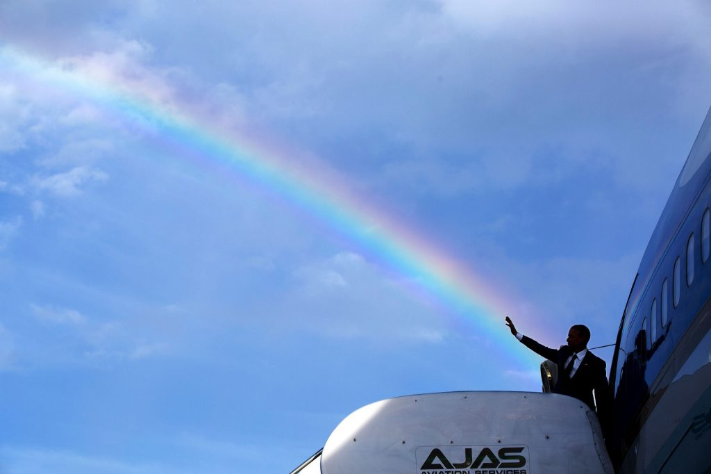 """April 9, 2015 """"The President's wave aligns with a rainbow as he boards Air Force One at Norman Manley International Airport prior to departure from Kingston, Jamaica. Read my Behind The Lens account of this photograph: http://bit.ly/1NMjCjHtk ."""" (Official White House Photo by Pete Souza)"""