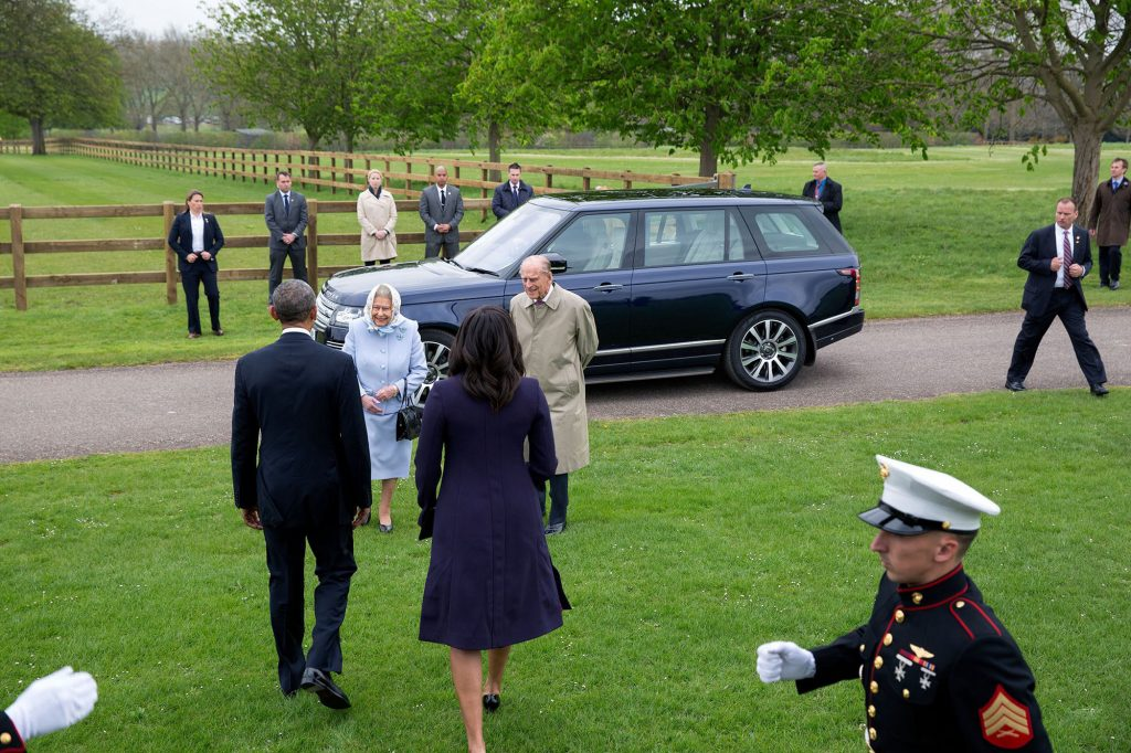 """April 22, 2016 """"I was under strict instructions not to exit the helicopter as Queen Elizabeth approached upon the President and First Lady's arrival. So I positioned myself near the cockpit to make this photograph. It's kind of a disjointed composition but I thought it showed what the scene is like to be welcomed by the Queen at Windsor Castle."""" (Official White House Photo by Pete Souza)"""