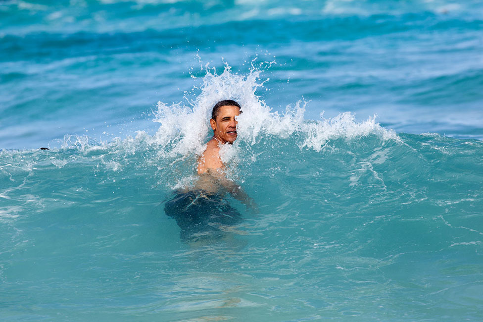"""January 1, 2012 """"A nice way to celebrate the New Year for the President was to jump in the ocean in his native state of Hawaii. He was on his annual Christmas vacation with family and friends, and went swimming at Pyramid Rock Beach in Kaneohe Bay."""" (Official White House Photo by Pete Souza)"""