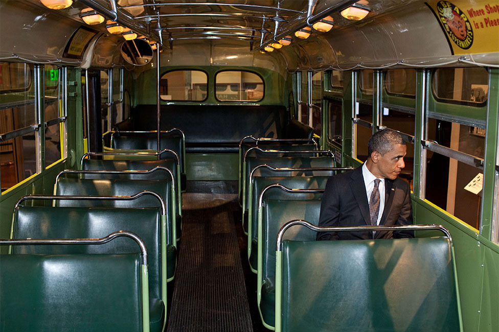 """April 18, 2012 """"We were doing an event at the Henry Ford Museum in Dearborn, Mich. Before speaking, the President was looking at some of the automobiles and exhibits adjacent to the event, and before I knew what was happening he walked onto the famed Rosa Parks bus. He sat in one of the seats, looking out the window for only a few seconds."""" (Official White House Photo by Pete Souza)"""