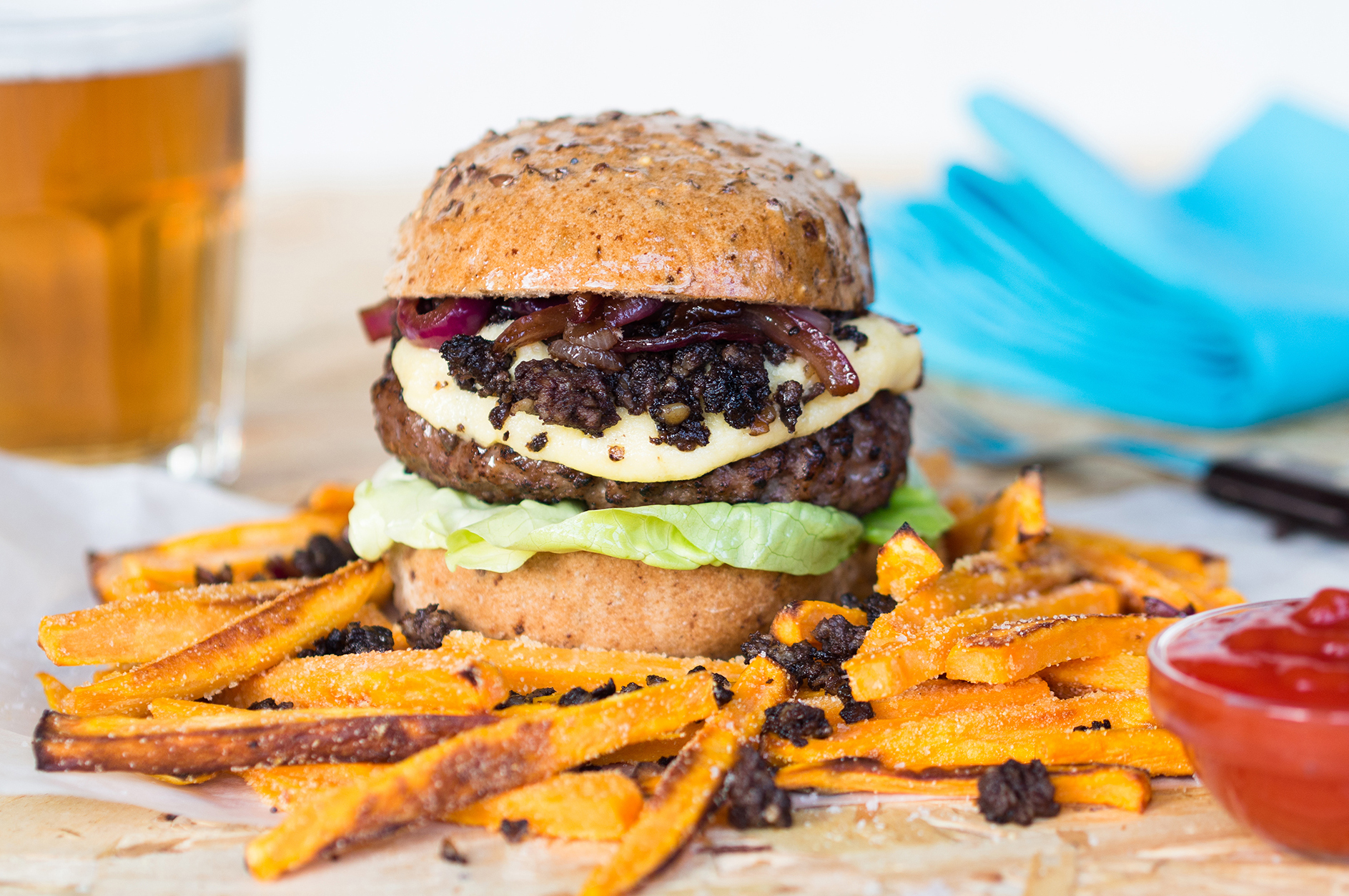 A Genius Gluten Free steak and haggis burger with red onion relish