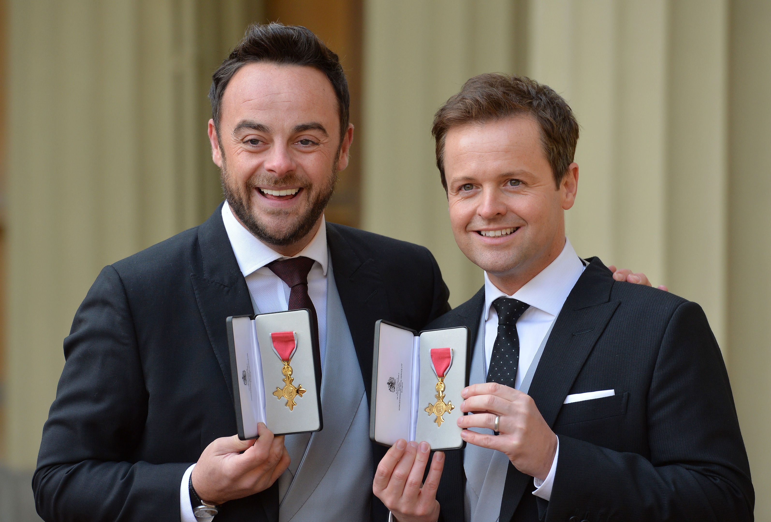 TV presenters Ant and Dec after they were presented with OBEs by the Prince of Wales (PA)
