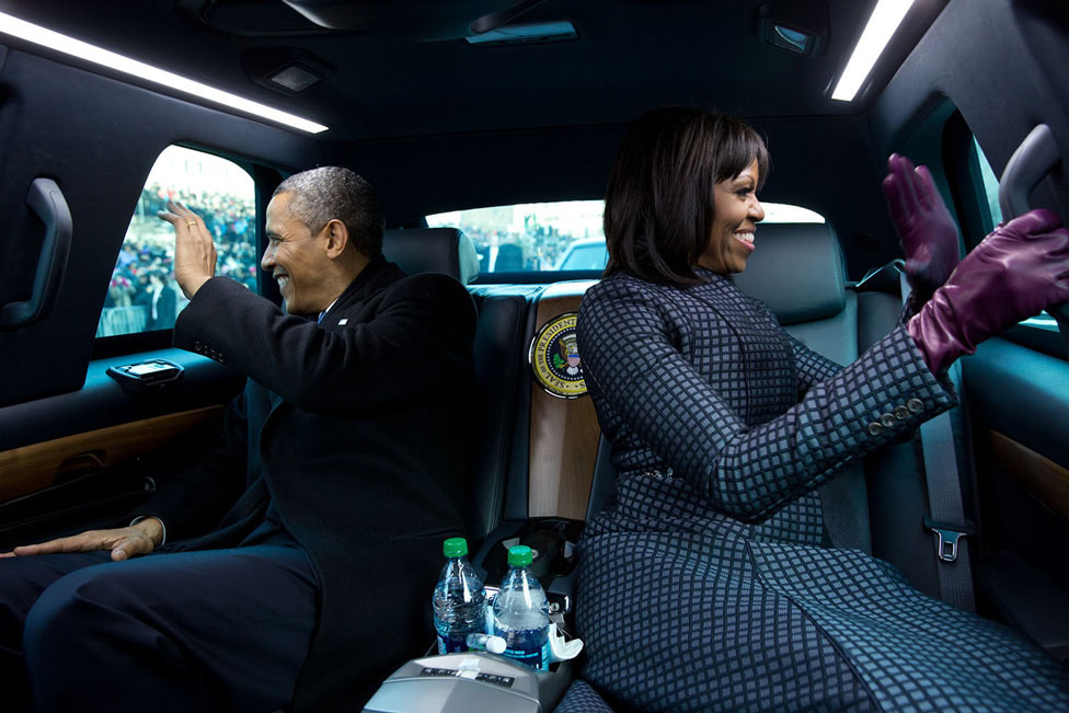"""January 21, 2013 """"The President and First Lady wave to supporters as they ride in the inaugural parade. I had asked the President if I could ride in the presidential limousine and the President joked, 'But Michelle and I were planning to make out.'"""" (Official White House Photo by Pete Souza)"""