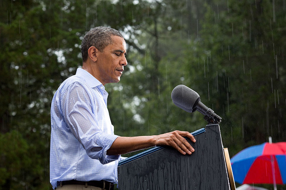 """July 14, 2012 """"The President delivers remarks in the pouring rain at a campaign event in Glen Allen, Va. He was supposed to do a series of press interviews inside before his speech, but since people had been waiting for hours in the rain he did his remarks as soon as he arrived at the site so people could go home to dry off ."""" (Official White House Photo by Pete Souza)"""