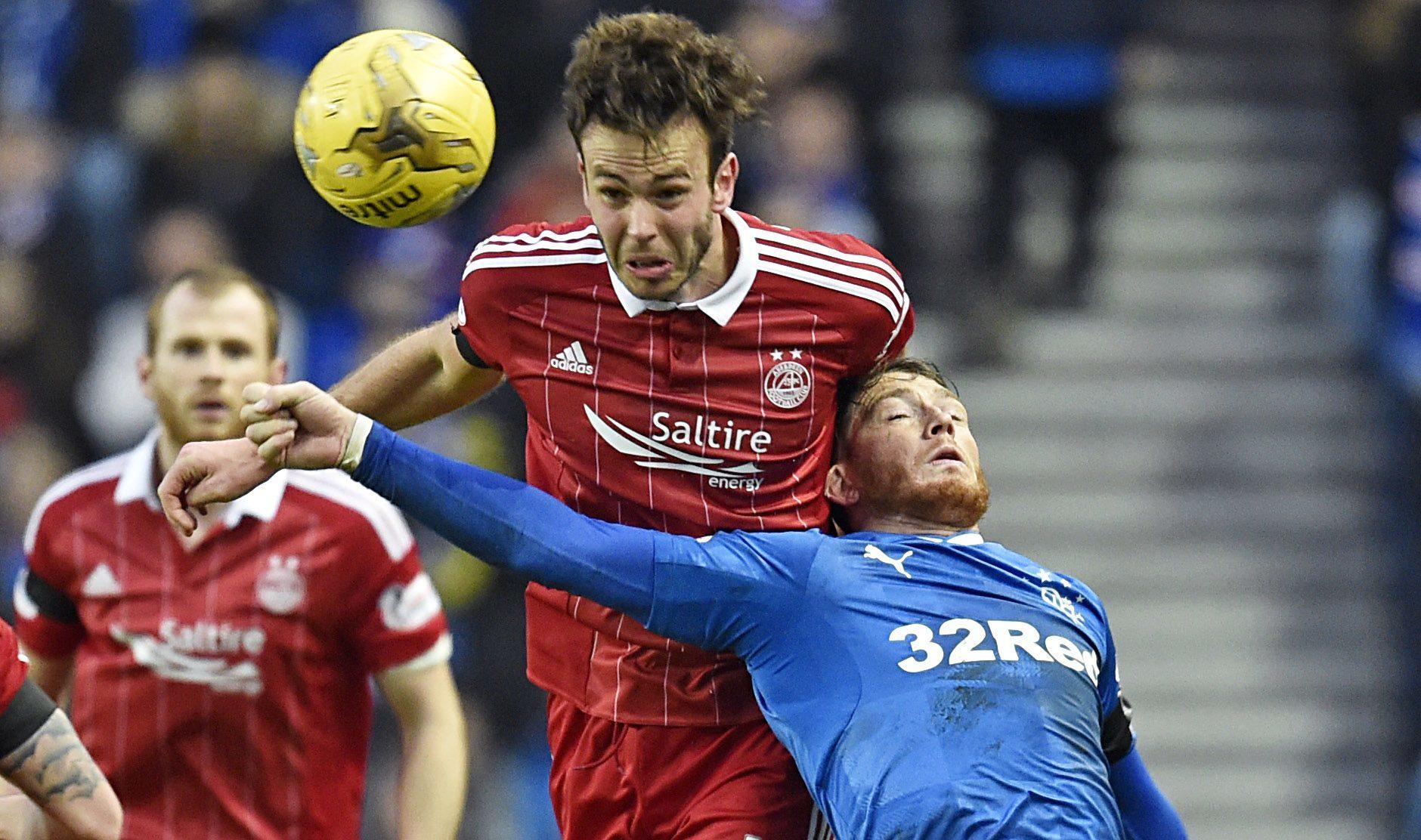 Andrew Considine battles for the ball with Rangers striker Joe Garner (SNS Group)