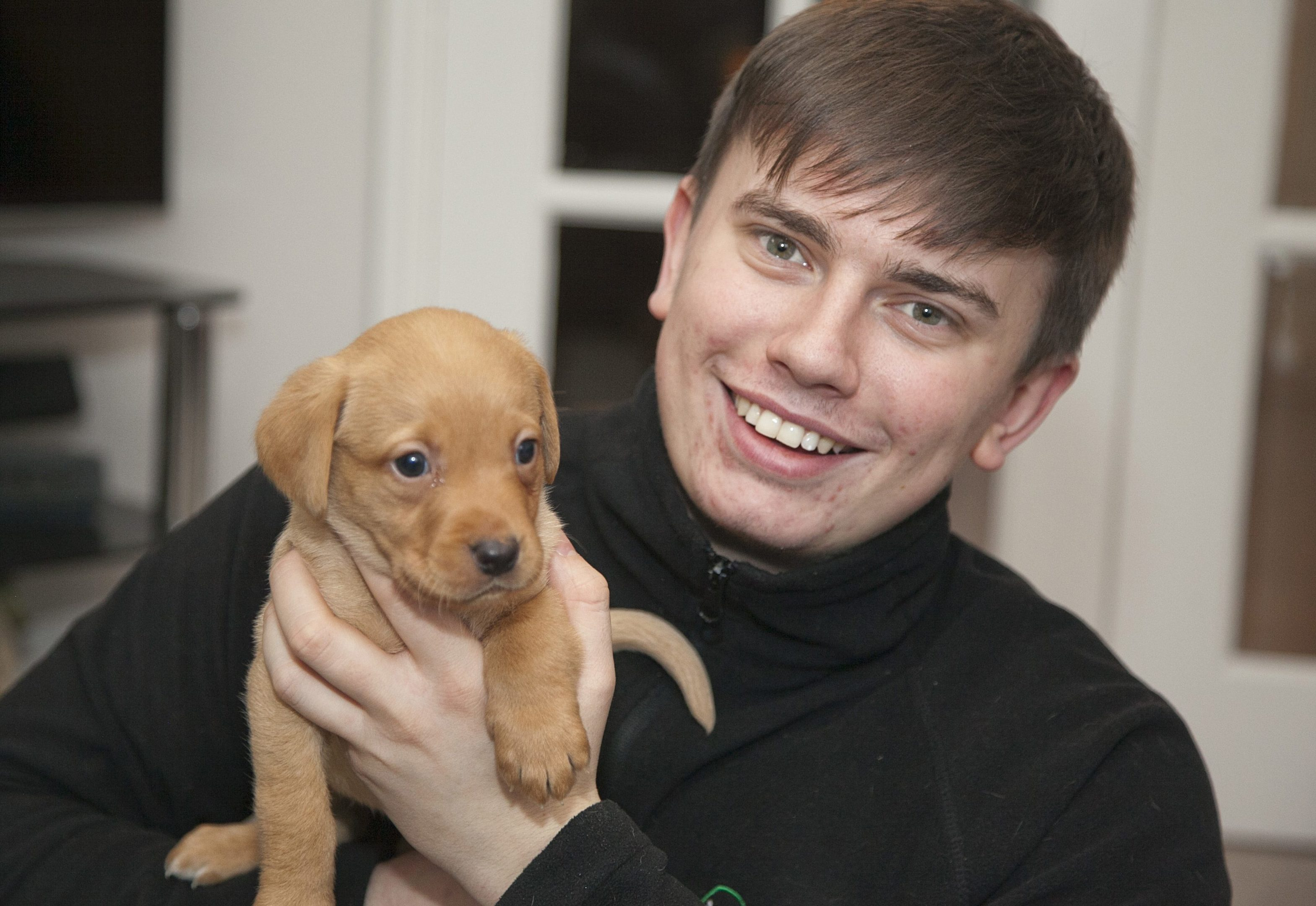Kris Paterson with Holly the puppy (Alistair Linford)