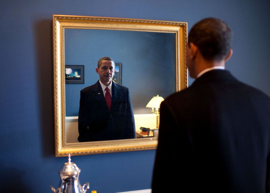 """Jan. 20, 2009 """"President-elect Barack Obama was about to walk out to take the oath of office. Backstage at the U.S. Capitol, he took one last look at his appearance in the mirror."""" (Official White House photo by Pete Souza)"""