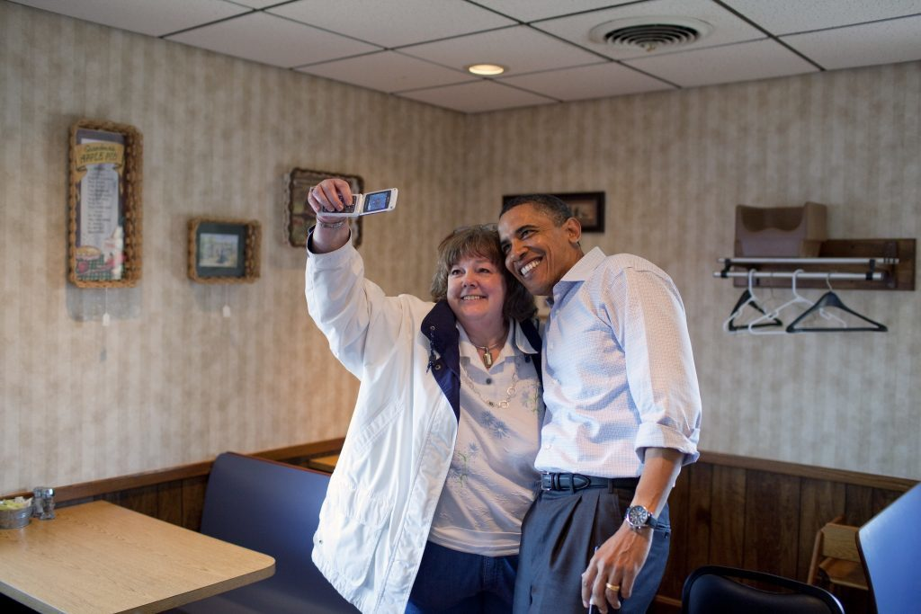 President Barack Obama poses for a photo with a patron at Jerry's Family Restaurant, a diner in Mount Pleasant, Iowa, April 27, 2010. (Official White House Photo by Pete Souza)