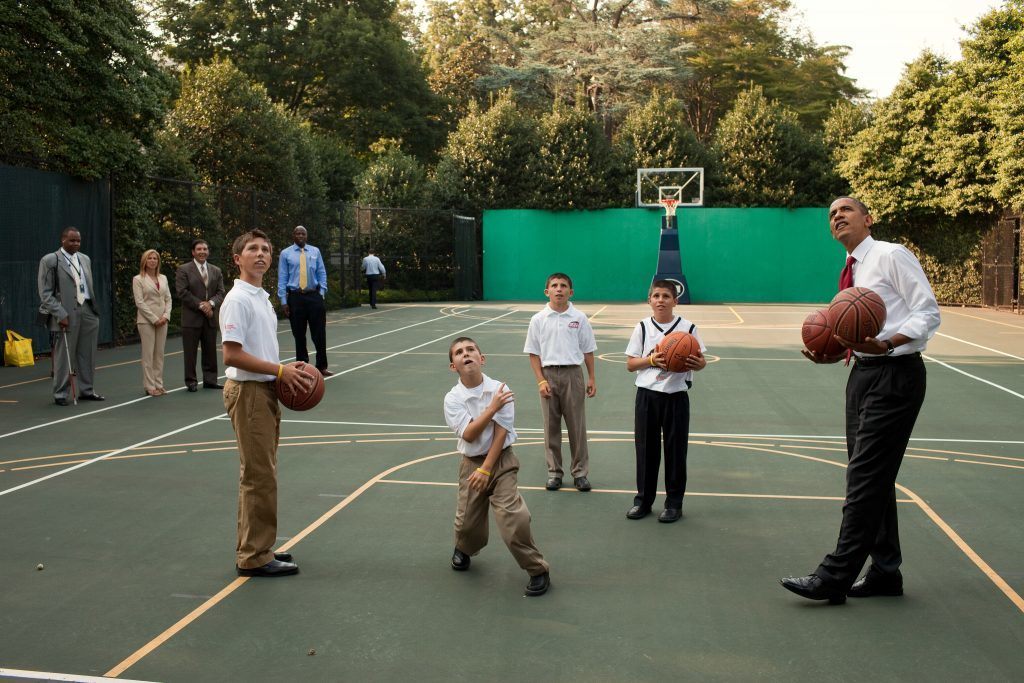President Barack Obama shoots baskets on the White House basketball court with Justin Friedlander and his family, July 6, 2010. Friedlander, who was diagnosed with an inoperable brain tumor in March, 2009, has launched an initiative called ÒJustinÕs Quest,Ó in which he will shoot 40,000 basketball shots, one for every person diagnosed with a primary brain tumor each year in the United States. (Official White House Photo by Pete Souza) This official White House photograph is being made available only for publication by news organizations and/or for personal use printing by the subject(s) of the photograph. The photograph may not be manipulated in any way and may not be used in commercial or political materials, advertisements, emails, products, promotions that in any way suggests approval or endorsement of the President, the First Family, or the White House.