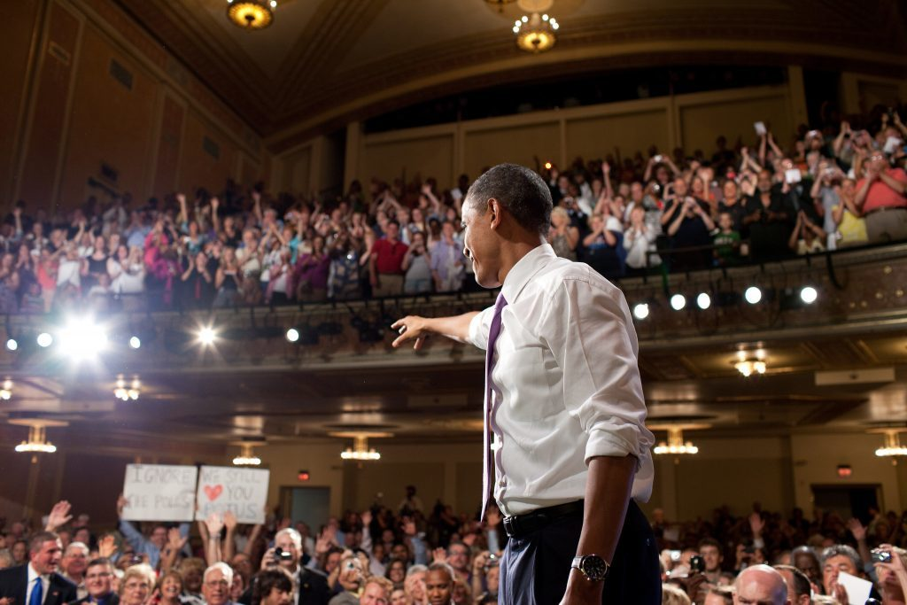 President Barack Obama waves to the crowd at a grassroots event for Missouri Secretary of State Robin Carnahan at the Folly Theater Auditorium in Kansas City, Mo., July 8, 2010. (Official White House Photo by Pete Souza) This official White House photograph is being made available only for publication by news organizations and/or for personal use printing by the subject(s) of the photograph. The photograph may not be manipulated in any way and may not be used in commercial or political materials, advertisements, emails, products, promotions that in any way suggests approval or endorsement of the President, the First Family, or the White House.