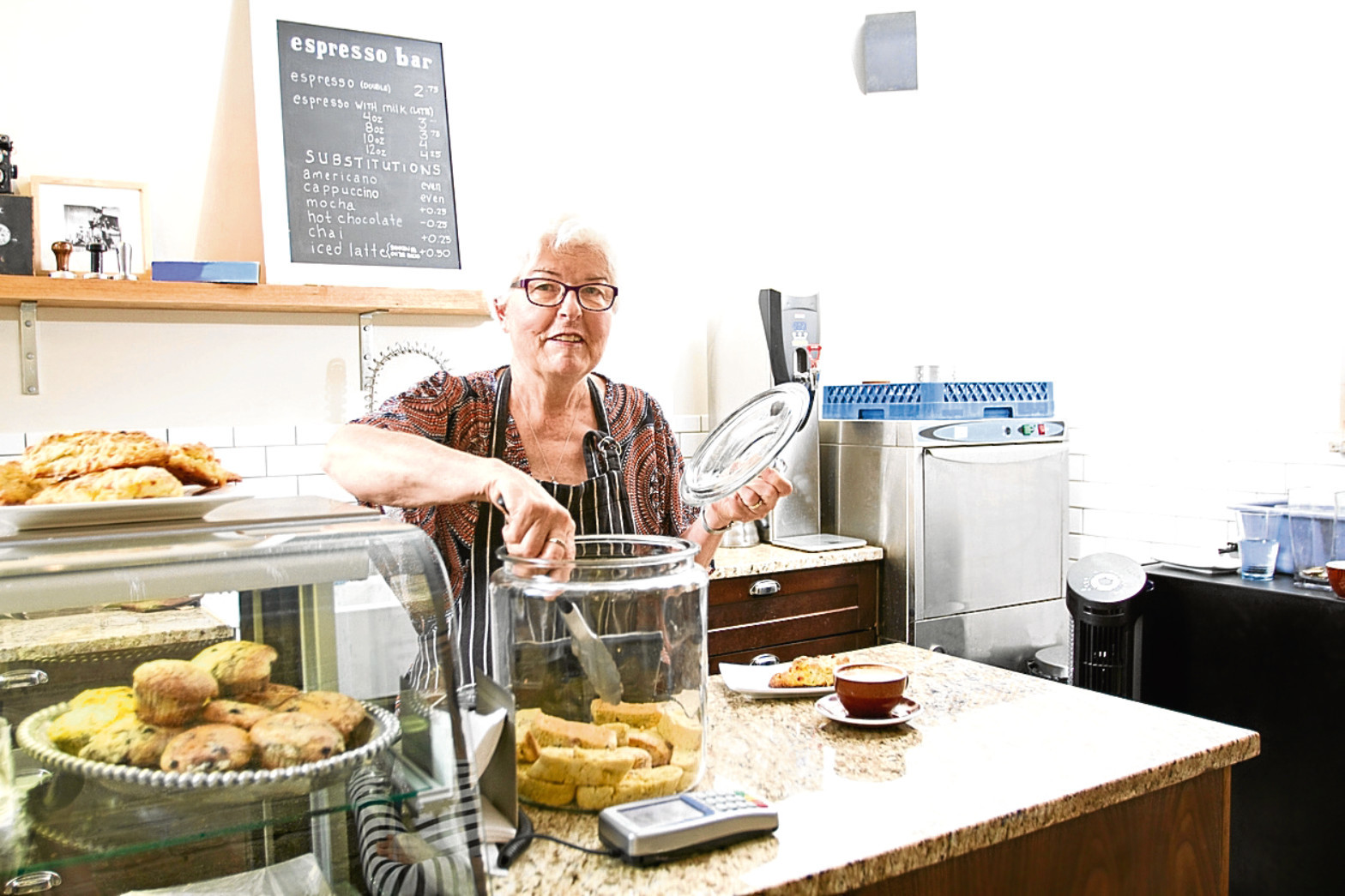 Senior lady working in coffee shop (Getty Images)
