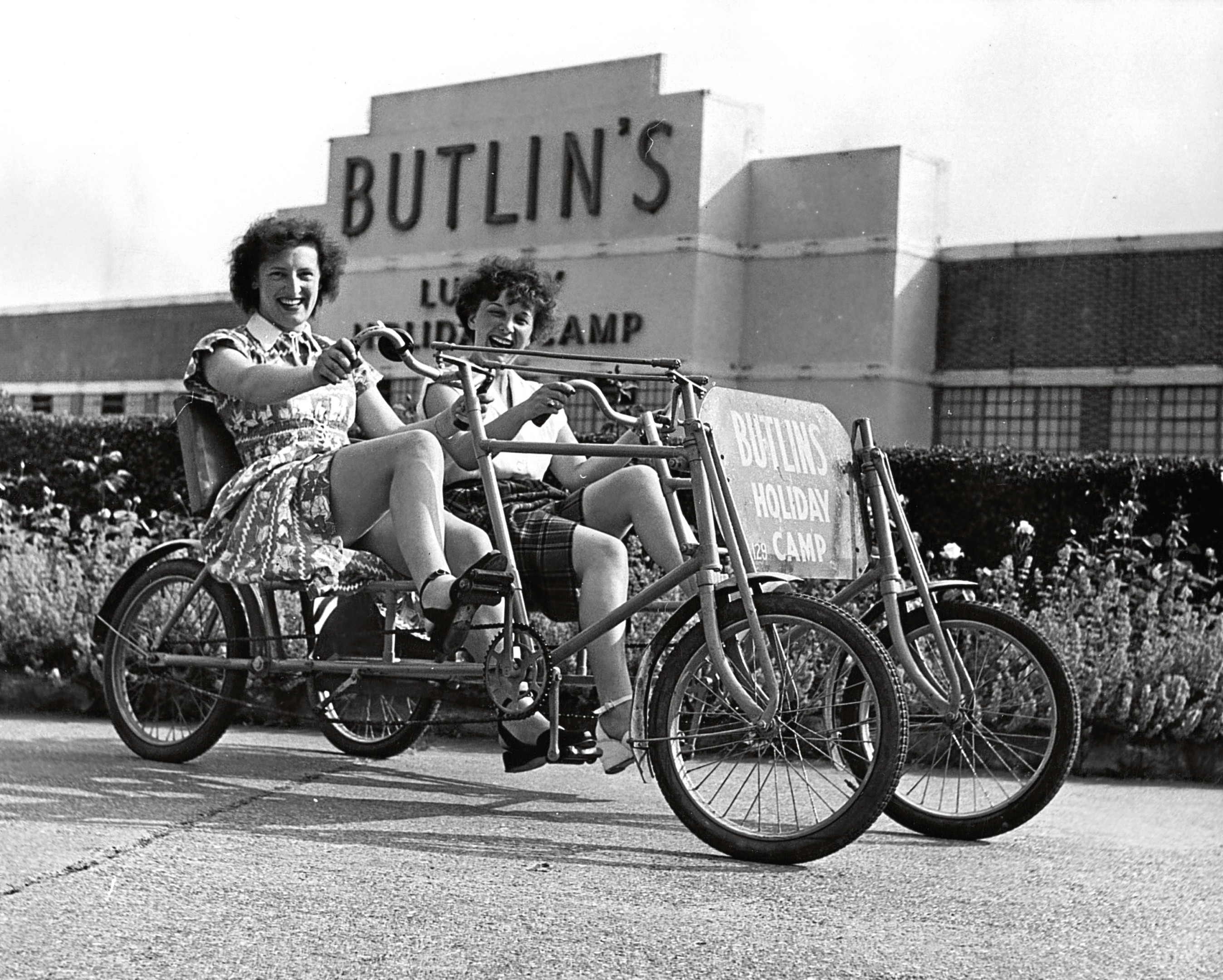 Holidaymakers riding a bicycle for two at Butlin's Holiday Camp in Clacton.    (Hulton Archive/Getty Images)