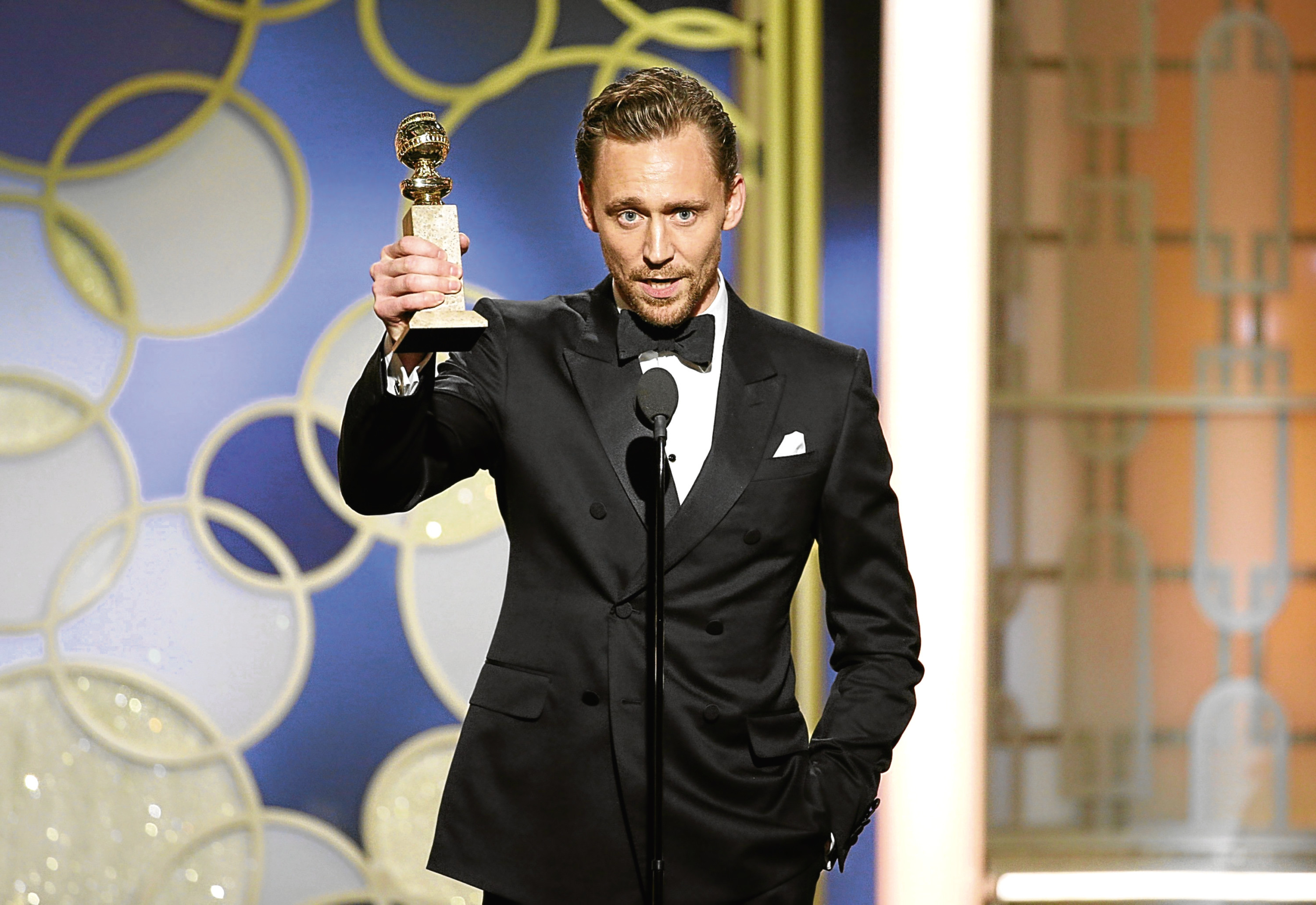Tom Hiddleston accepts the award for Best Actor - Limited Series or Motion Picture (Paul Drinkwater/NBCUniversal via Getty Images)