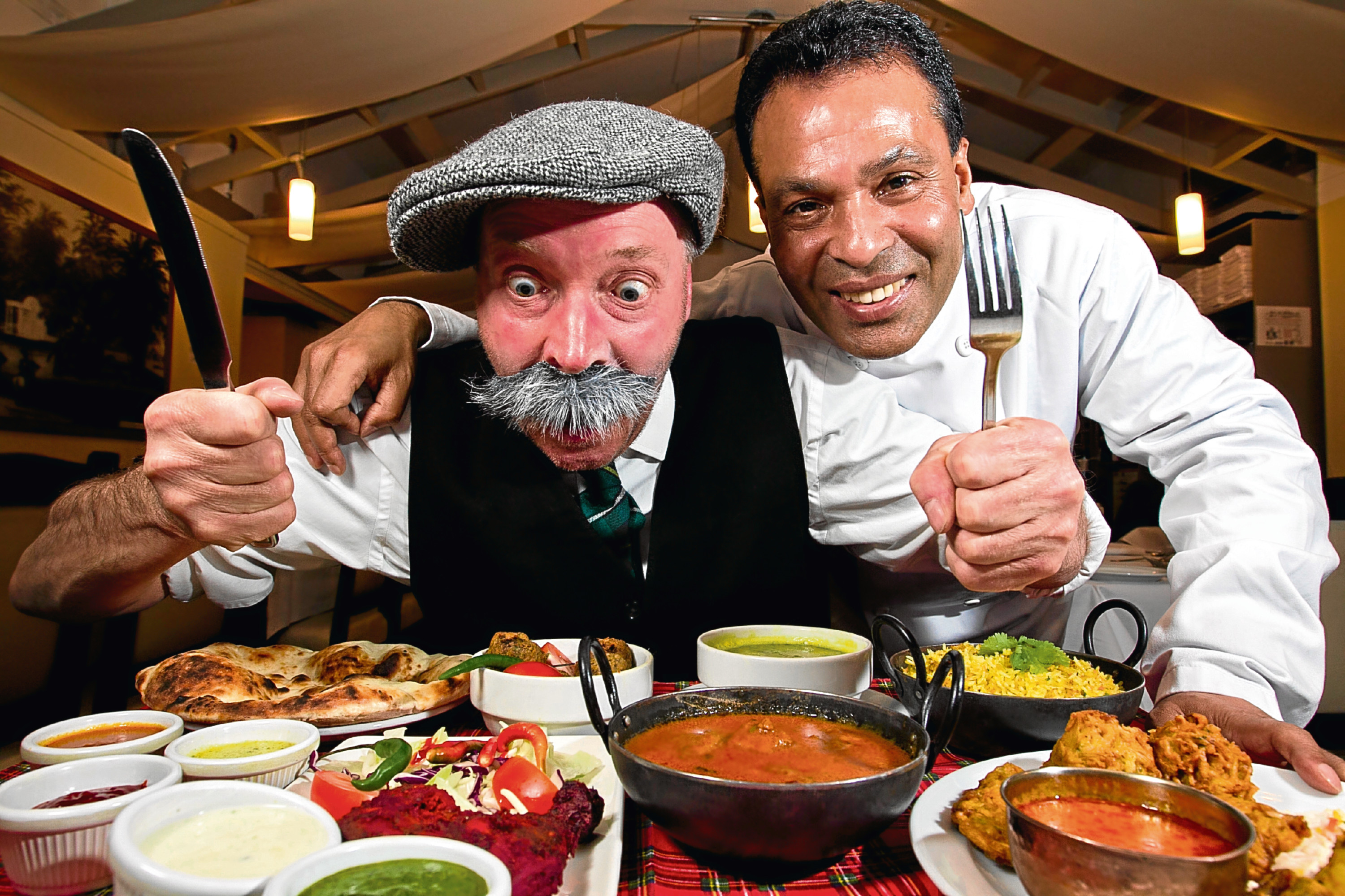 Paw Broon (Gordon Campbell) and Tommy Miah, owner of The Raj restaurant (Andrew Cawley / DC Thomson)