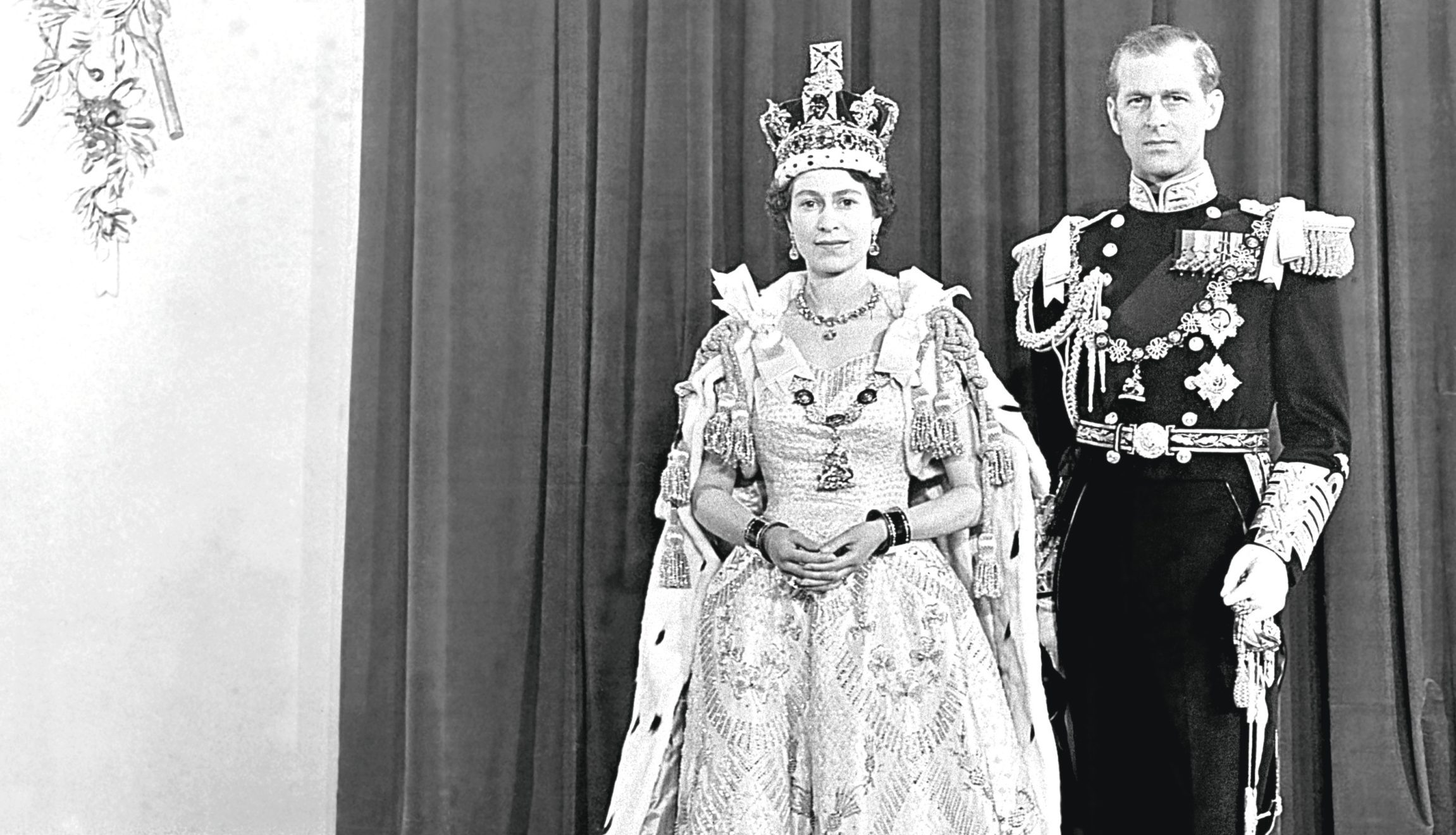 Queen Elizabeth II and her husband the Duke of Edinburgh at Buckingham Palace after her coronation in Westminster Abbey
