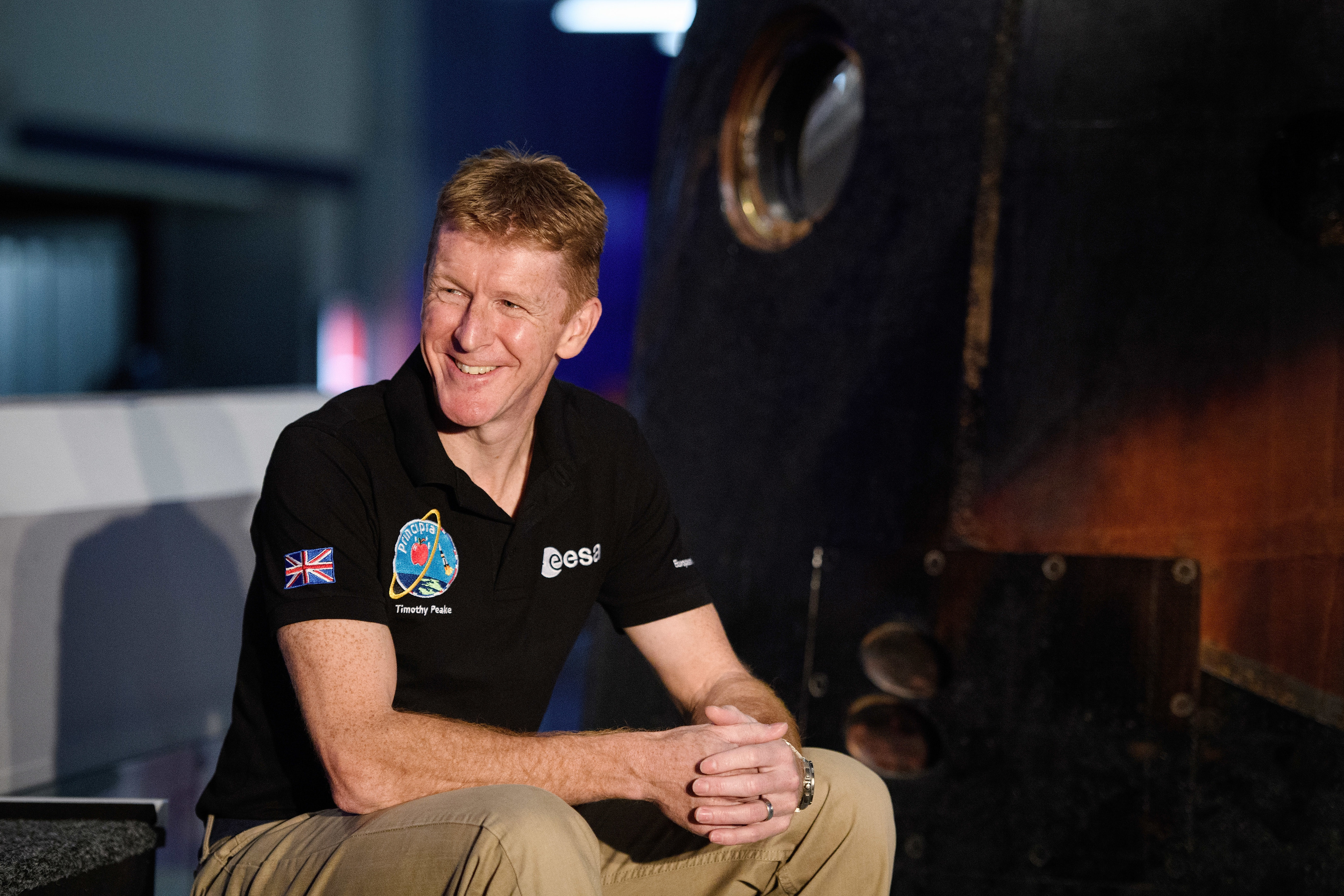 British astronaut Tim Peake poses with the Soyuz TMA-19M descent module which he used to return from the International Space Station (Leon Neal/Getty Images)