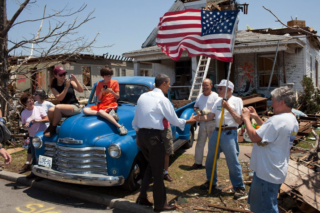 """May 29, 2011 """"The President visited Joplin, Missouri, following a devastating tornado. Here he greets Hugh Hills, 85, in front of his home. Hills told the President he hid in a closet during the tornado, which destroyed the second floor and half the first floor of his house."""" (Official White House Photo by Pete Souza)"""
