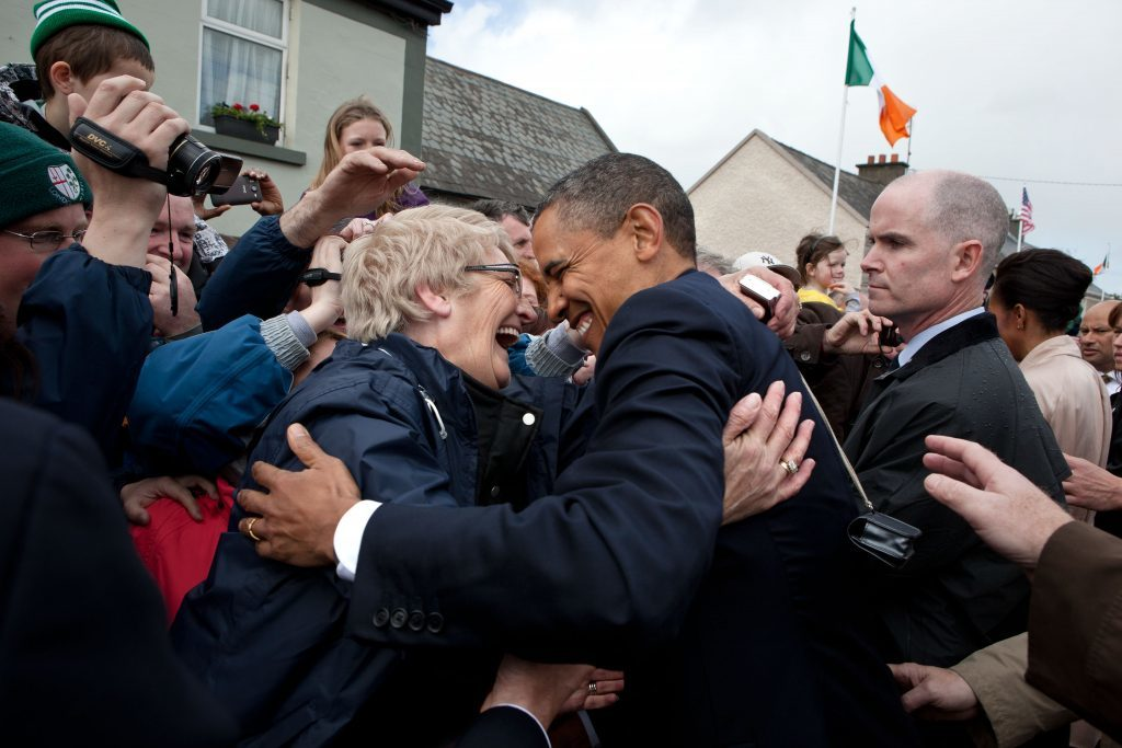 """May 23, 2011 """"This was one of the great trips of the year, albeit brief, when we visited Ireland in May. This rope line in Moneygall was particularly fun as people reacted so jubilantly to the President and First Lady. It was somewhat unusual, though, in that the sun kept coming in and out, and at times it was even pouring rain."""" (Official White House Photo by Pete Souza) This official White House photograph is being made available only for publication by news organizations and/or for personal use printing by the subject(s) of the photograph. The photograph may not be manipulated in any way and may not be used in commercial or political materials, advertisements, emails, products, promotions that in any way suggests approval or endorsement of the President, the First Family, or the White House."""
