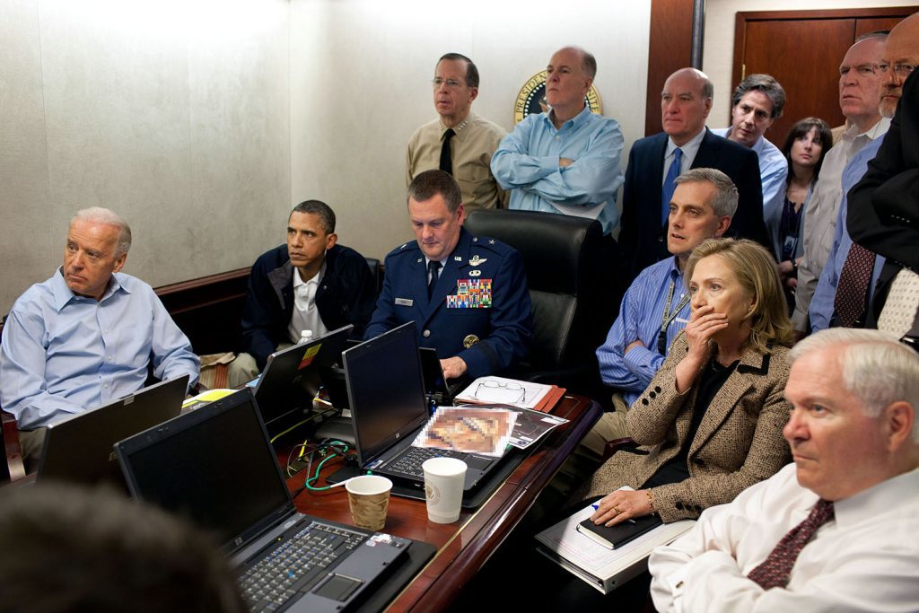 """May 1, 2011 """"Much has been made of this photograph that shows the President and Vice President and the national security team monitoring in real time the mission against Osama bin Laden. Some more background on the photograph: The White House Situation Room is actually comprised of several different conference rooms. The majority of the time, the President convenes meetings in the large conference room with assigned seats. But to monitor this mission, the group moved into the much smaller conference room. The President chose to sit next to Brigadier General Marshall B. """"Brad"""" Webb, Assistant Commanding General of Joint Special Operations Command, who was point man for the communications taking place. WIth so few chairs, others just stood at the back of the room. I was jammed into a corner of the room with no room to move. During the mission itself, I made approximately 100 photographs, almost all from this cramped spot in the corner. There were several other meetings throughout the day, and we've put together a composite of several photographs (see next photo in this set) to give people a better sense of what the day was like. Seated in this picture from left to right: Vice President Biden, the President, Brig. Gen. Webb, Deputy National Security Advisor Denis McDonough, Secretary of State Hillary Rodham Clinton, and then Secretary of Defense Robert Gates. Standing, from left, are: Admiral Mike Mullen, then Chairman of the Joint Chiefs of Staff; National Security Advisor Tom Donilon; Chief of Staff Bill Daley; Tony Blinken, National Security Advisor to the Vice President; Audrey Tomason Director for Counterterrorism; John Brennan, Assistant to the President for Homeland Security and Counterterrorism; and Director of National Intelligence James Clapper. Please note: a classified document seen in front of Sec. Clinton has been obscured."""" (Official White House Photo by Pete Souza) This official White House photograph is being made available only for publication"""