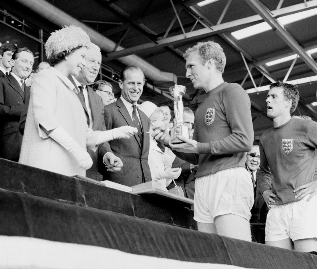 England captain Bobby Moore holds the Jules Rimet Trophy, collected from the Queen, after leading his team to a 4-2 victory over West Germany, in an exciting World Cup Final that went to extra time at Wembley, London.
